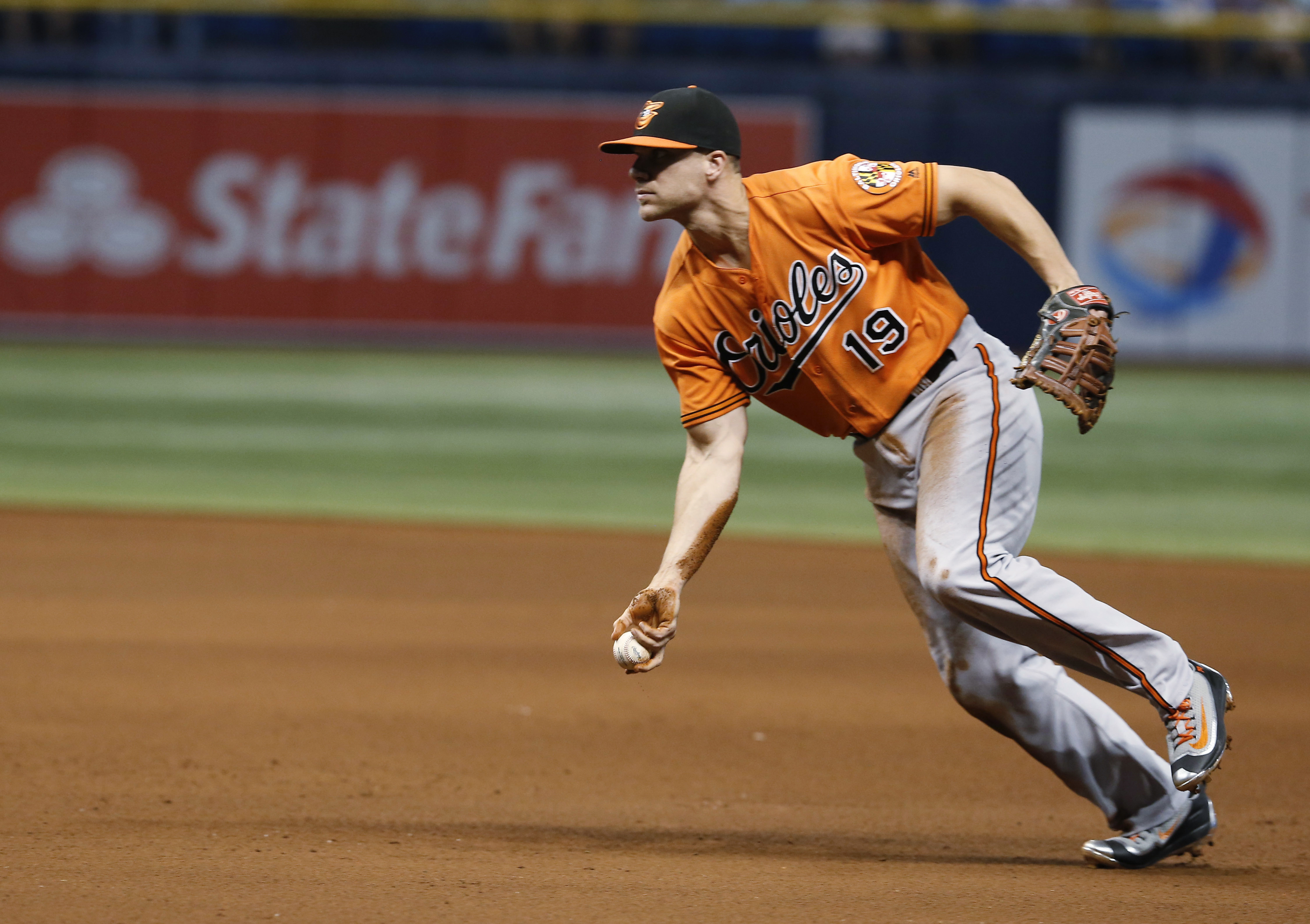 Baltimore Orioles first baseman Chris Davis tosses to first for the out on Tampa Bay Rays' Brad Miller during the eighth inning of a baseball game Saturday, July 16, 2016, in St. Petersburg, Fla. The Orioles won 2-1. (AP Photo/Reinhold Matay)
