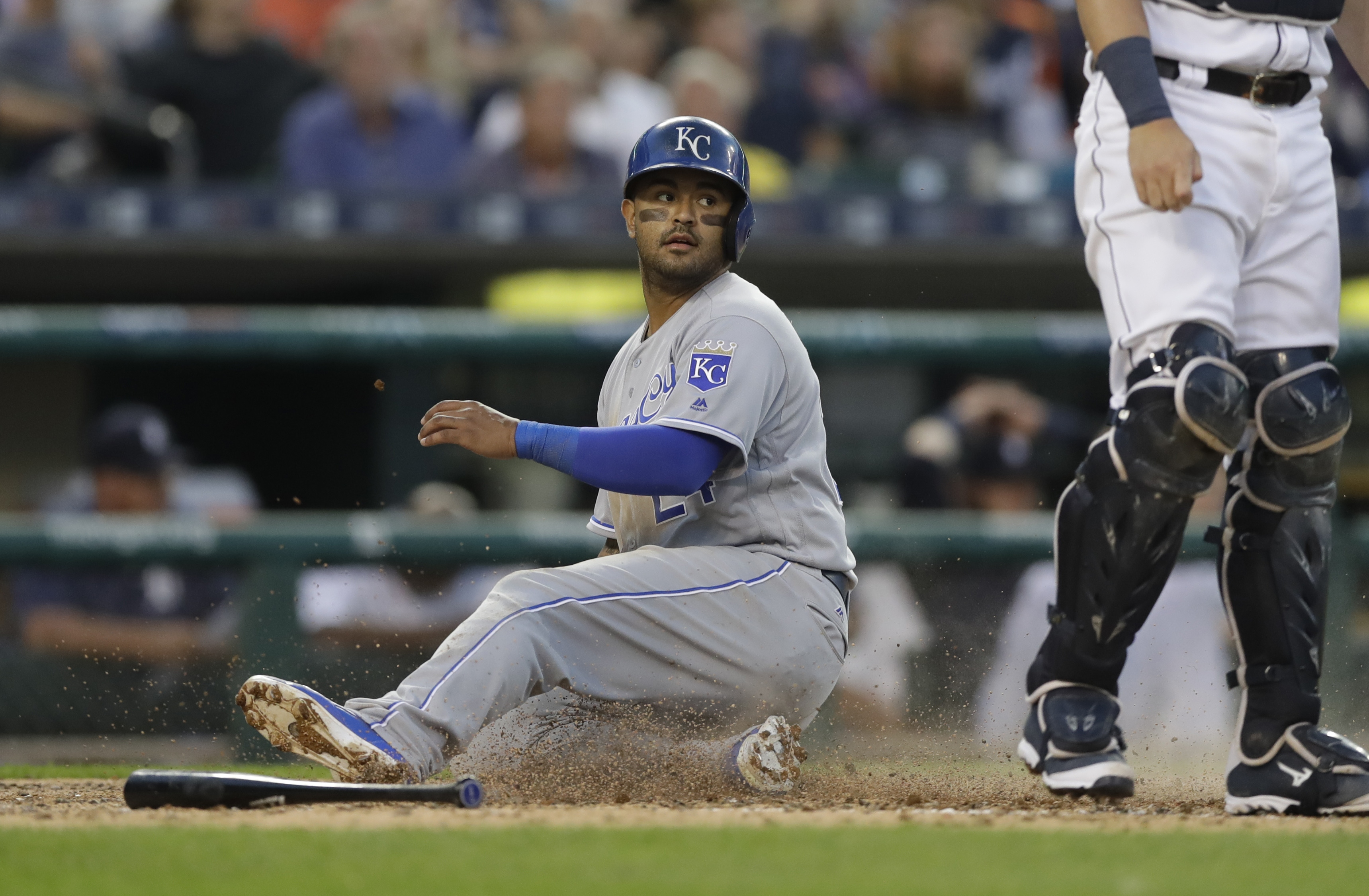 Kansas City Royals Christian Colon safely slides home from second on a single by Jarrod Dyson during the fifth inning of a baseball game against the Detroit Tigers, Saturday, July 16, 2016 in Detroit. (AP Photo/Carlos Osorio)