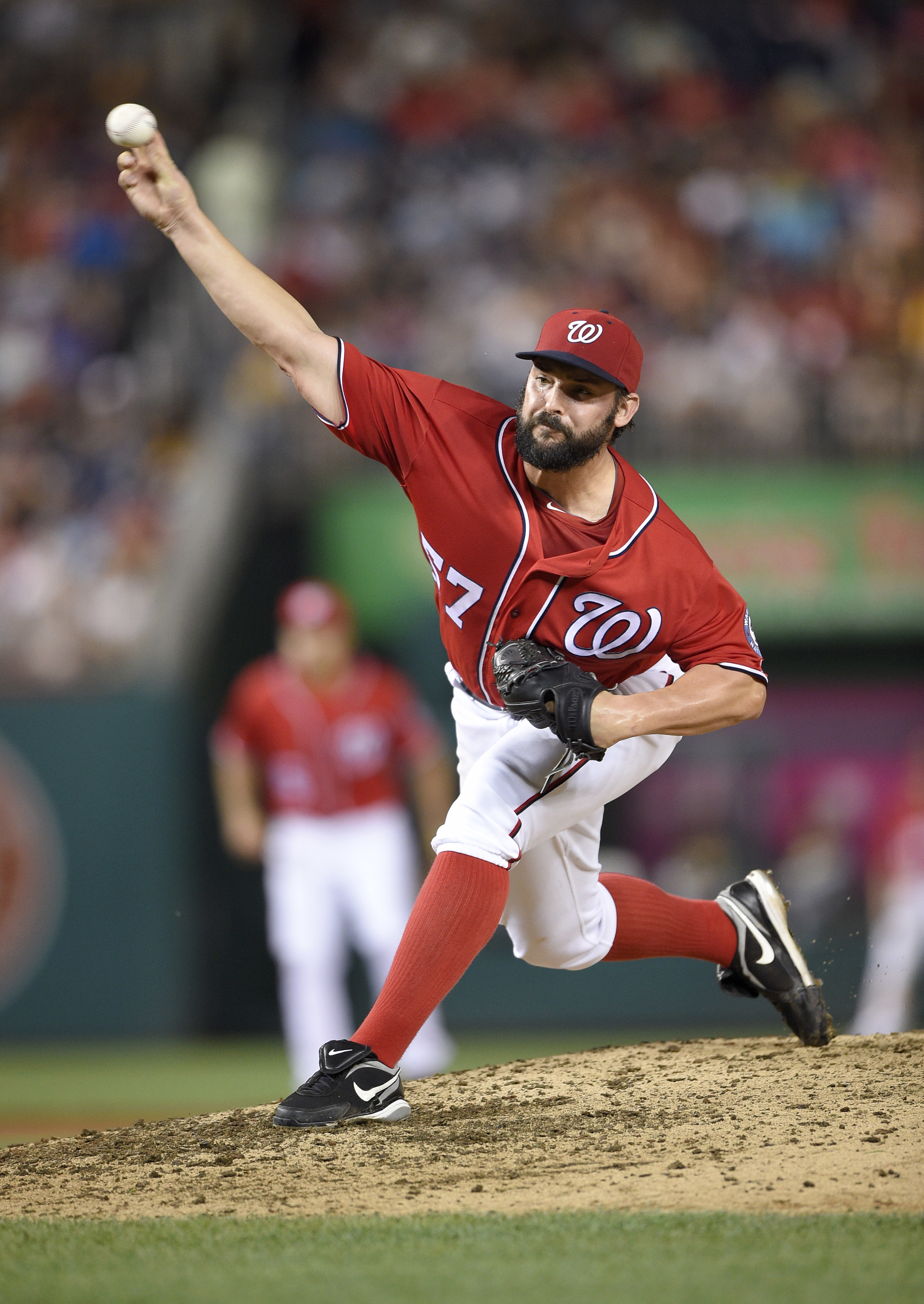 Washington Nationals starter Tanner Roark delivers a pitch during the eighth inning of a baseball game against the Pittsburgh Pirates, Saturday, July 16, 2016, in Washington. The Nationals won 6-0. (AP Photo/Nick Wass)