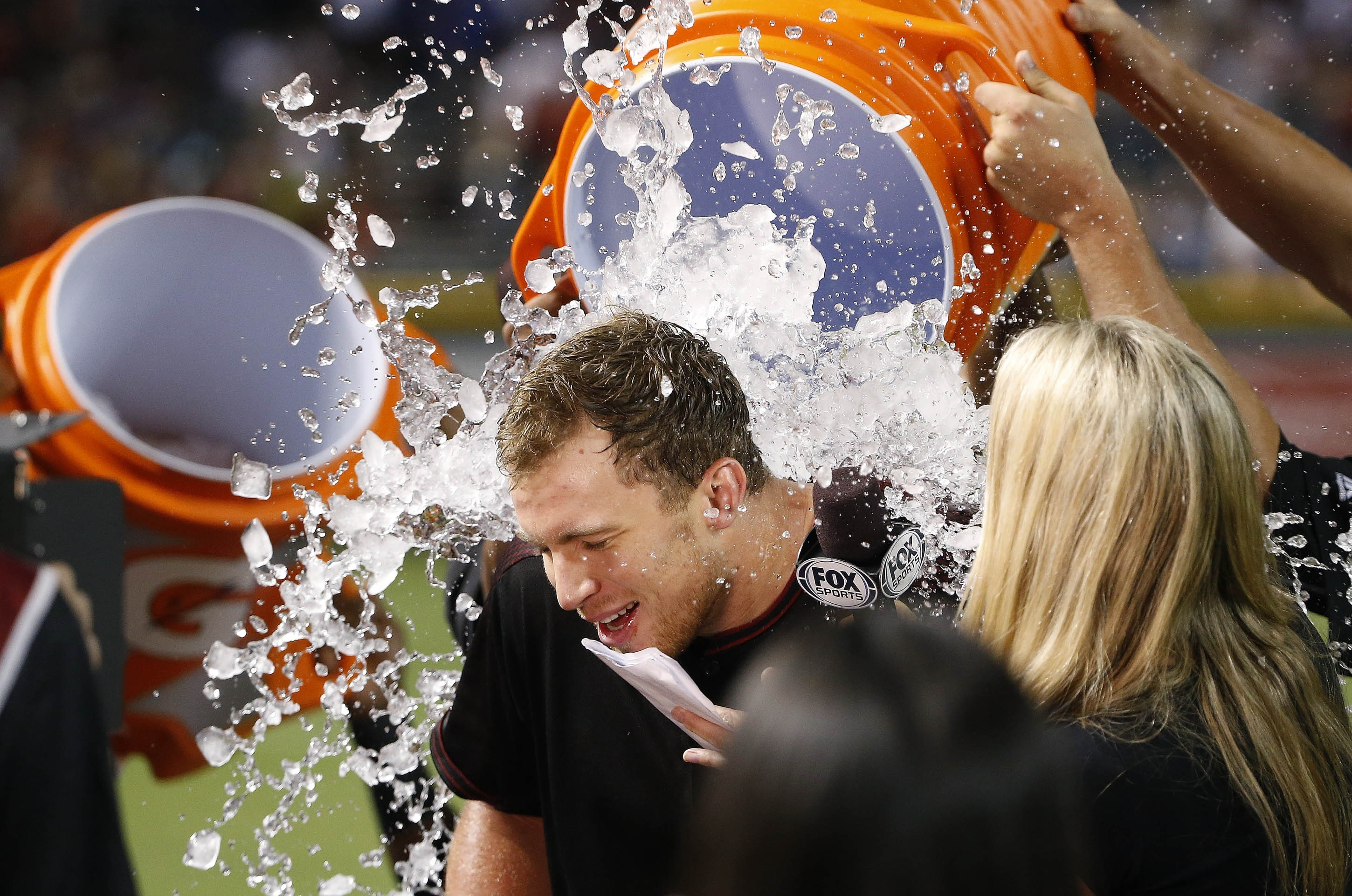 Arizona Diamondbacks' Brandon Drury is doused as teammates celebrate his game-winning single against the Los Angeles Dodgers in the 12th inning of a baseball game Saturday, July 16, 2016, in Phoenix. The Diamondbacks defeated the Dodgers 2-1. (AP Photo/Ro