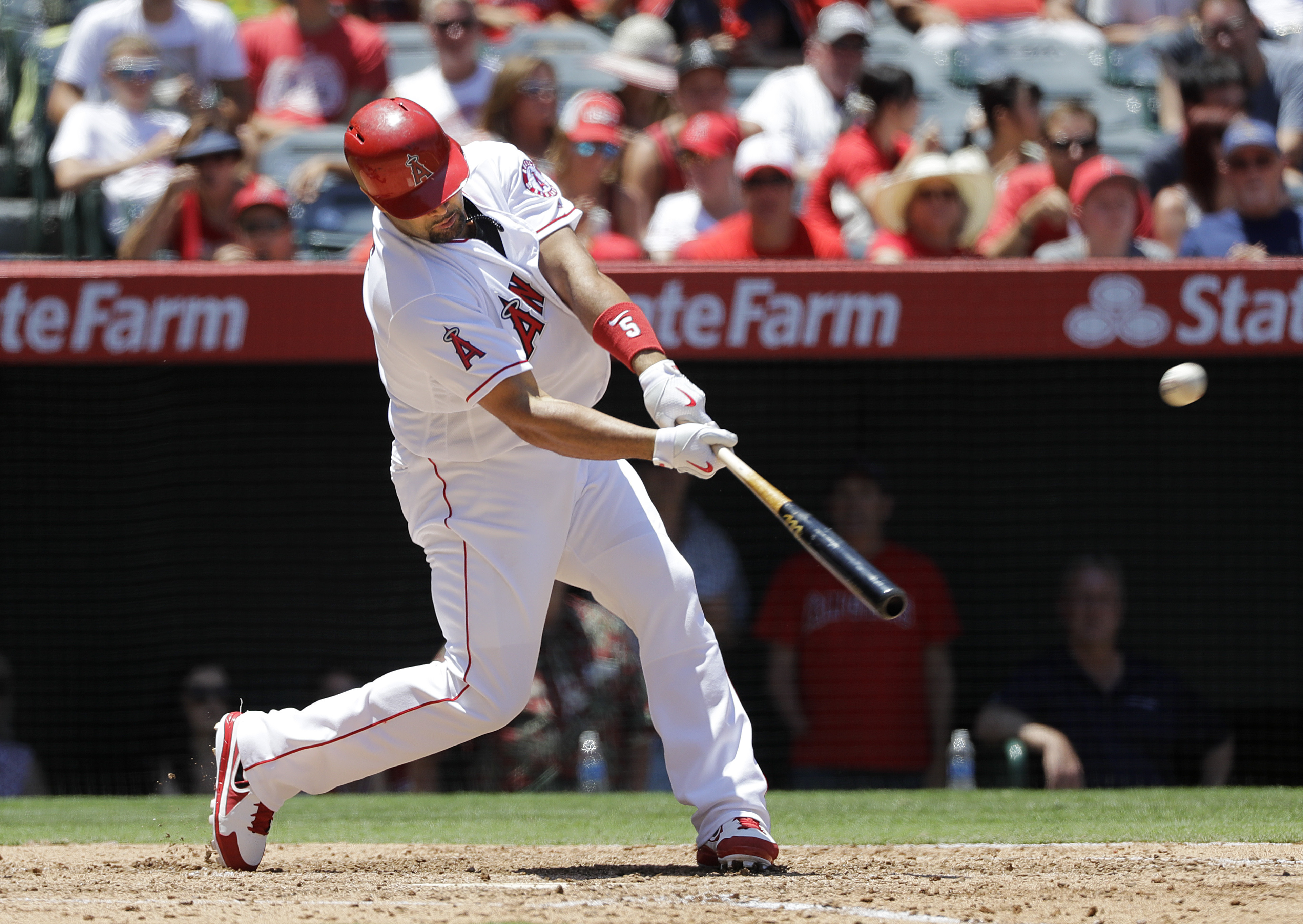 Los Angeles Angels' Albert Pujols hits a two-run home run, his second of the game, during the fourth inning of a baseball game against the Chicago White Sox, Sunday, July 17, 2016, in Anaheim, Calif. (AP Photo/Jae C. Hong)