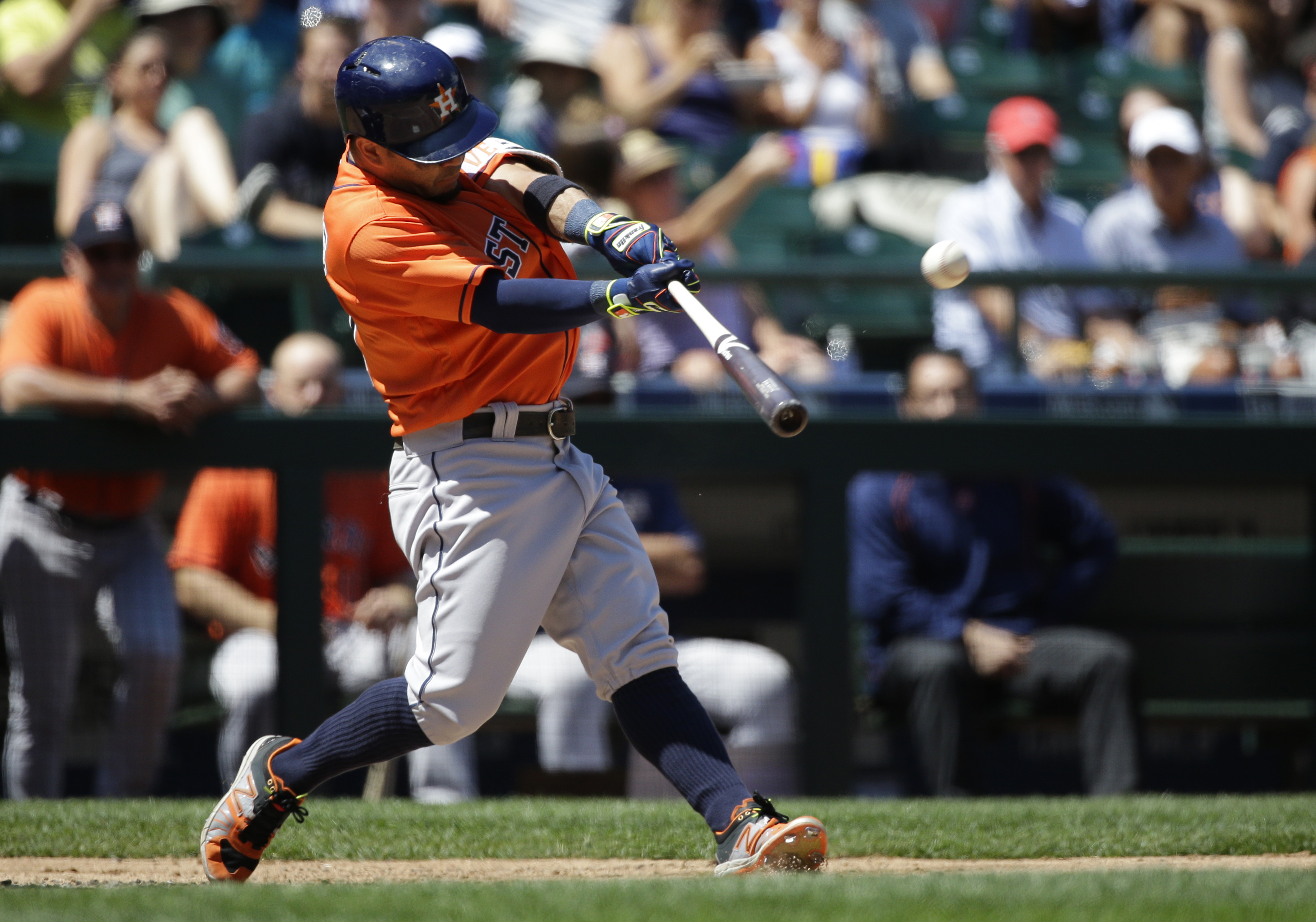 Houston Astros' Jose Altuve hits a two-run home run in the third inning of a baseball game against the Seattle Mariners, Sunday, July 17, 2016, in Seattle. Astros' Marwin Gonzalez also scored on the play. (AP Photo/Ted S. Warren)