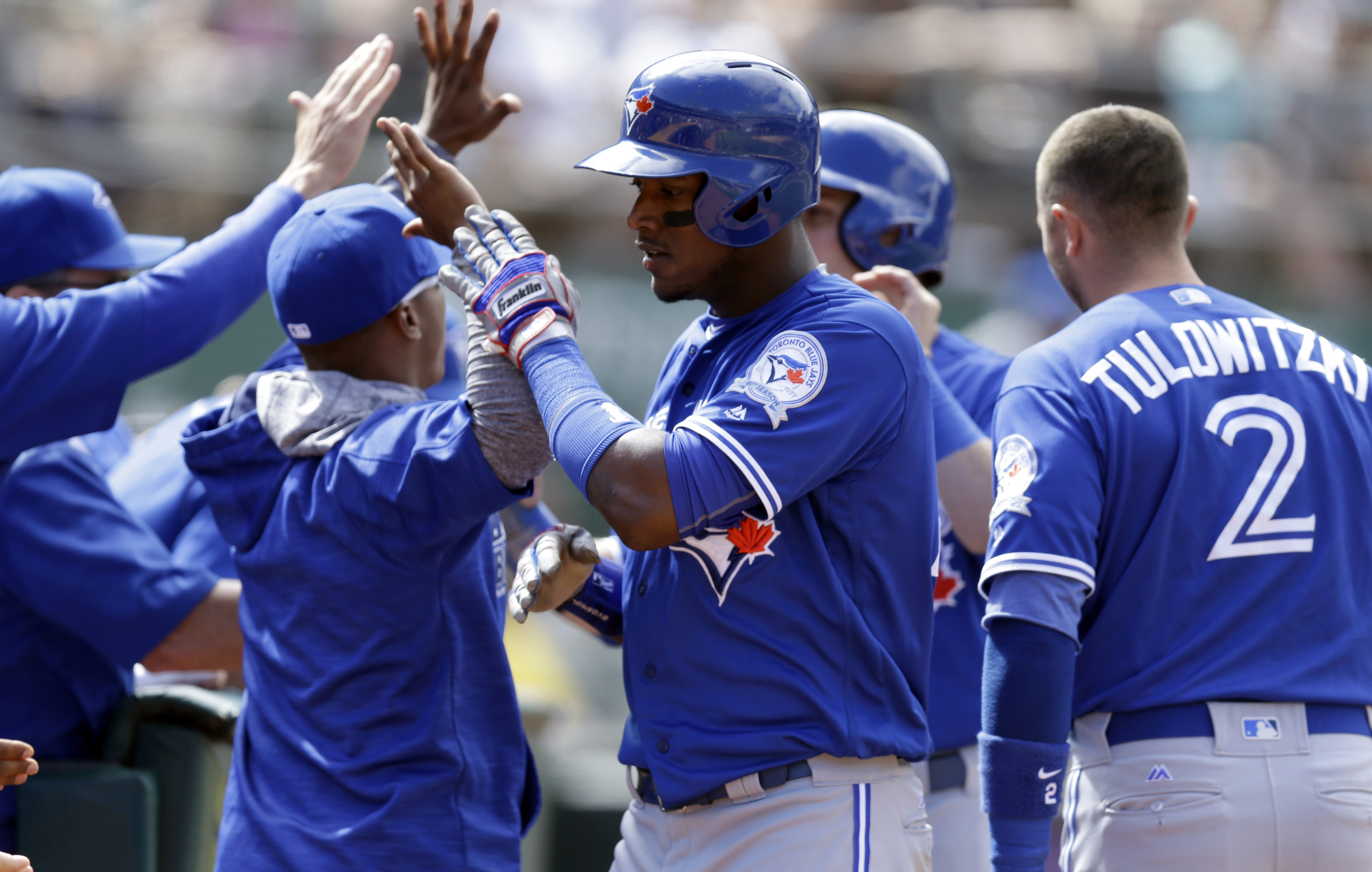 Toronto Blue Jays' Junior Lake celebrates after scoring against the Oakland Athletics in the ninth inning of a baseball game Sunday, July 17, 2016, in Oakland, Calif. Lake scored on a double by Toronto's Josh Donaldson. (AP Photo/Ben Margot)
