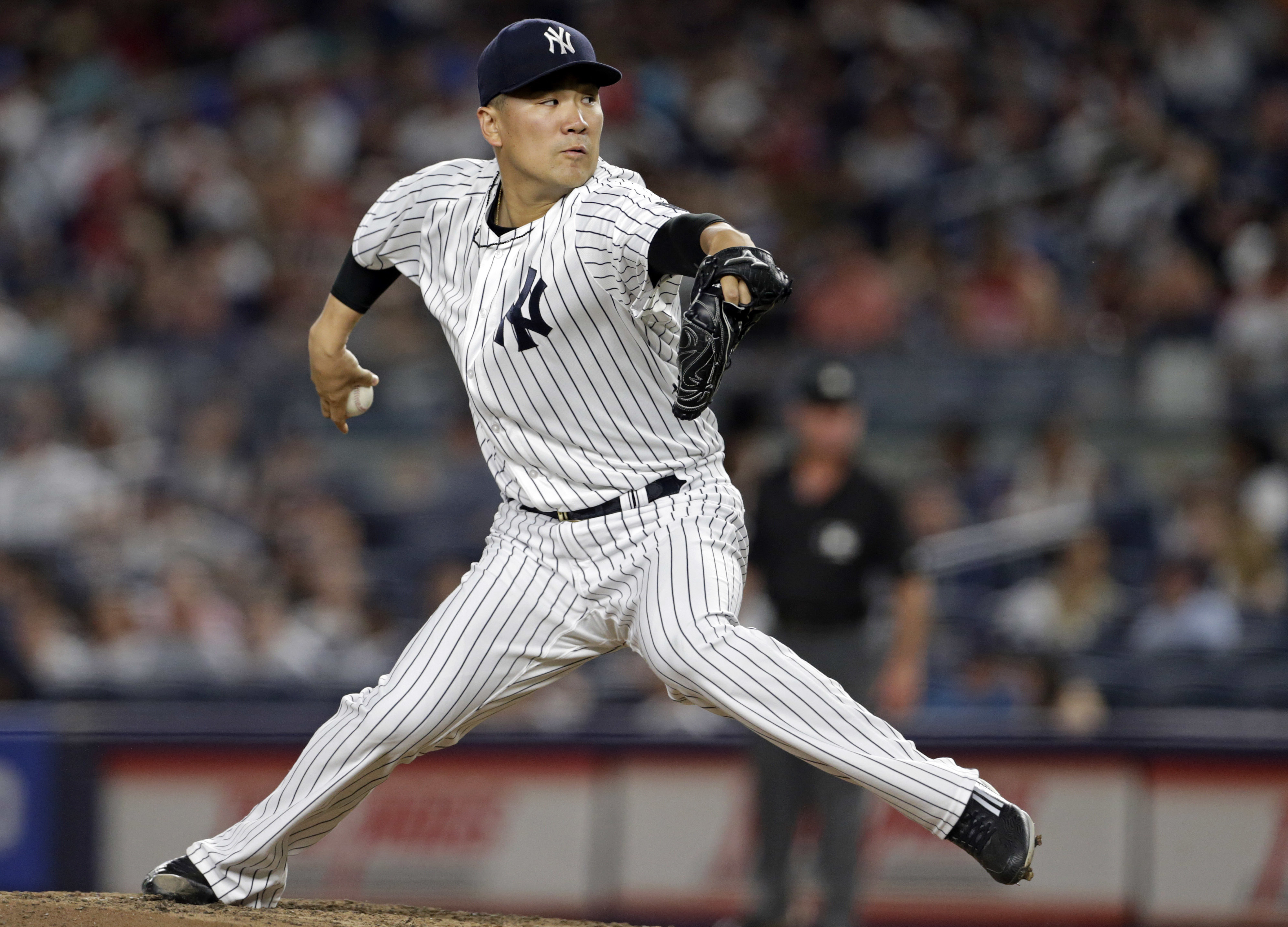 New York Yankees starting pitcher Masahiro Tanaka (19) delivers a pitch during the third inning of a baseball game against the Boston Red Sox on Sunday, July 17, 2016, in New York. (AP Photo/Adam Hunger)