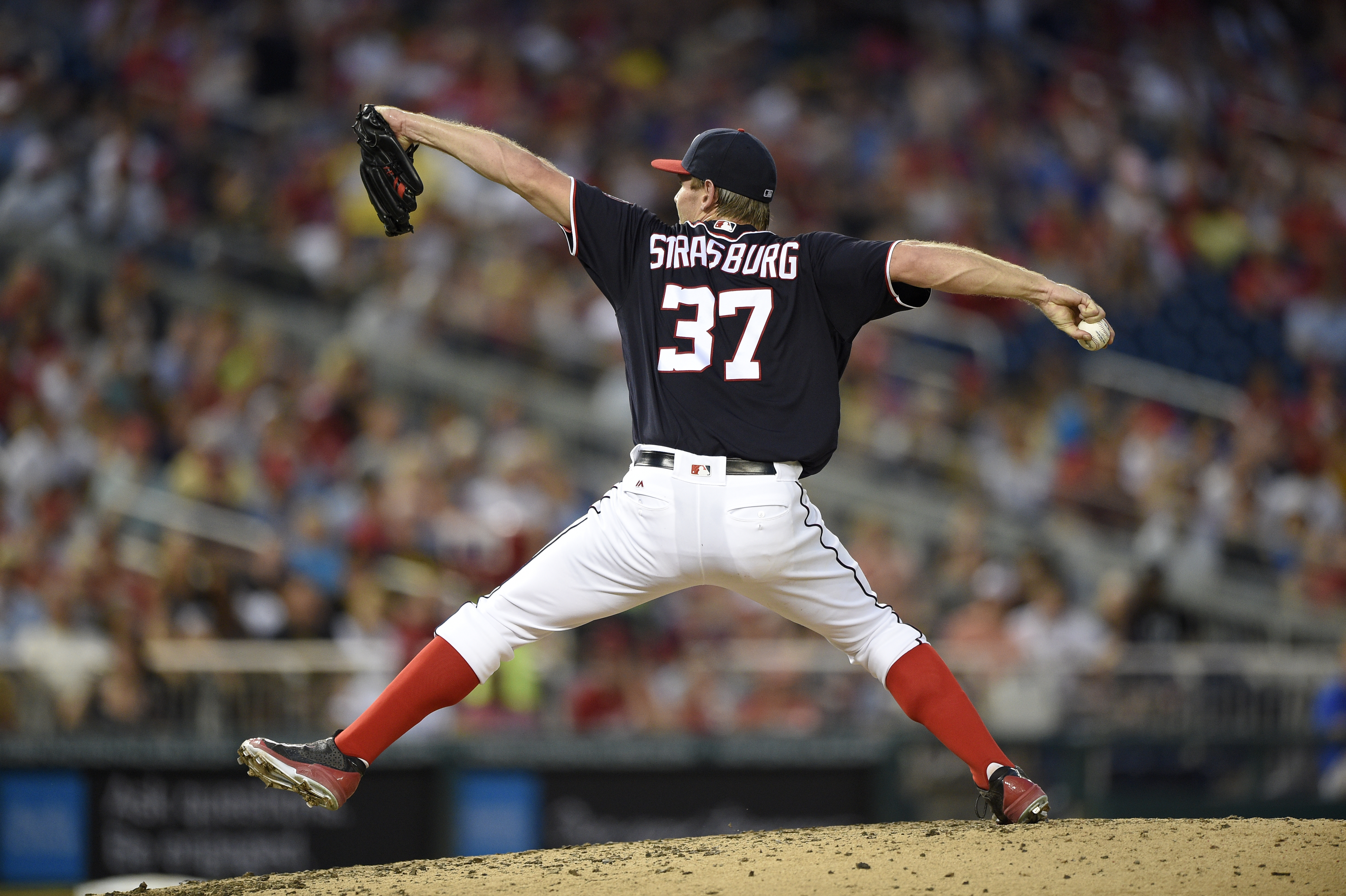 FILE - In this July 15, 2016, file photo, Washington Nationals starting pitcher Stephen Strasburg (37) delivers a pitch during the sixth inning of a baseball game against the Pittsburgh Pirates in Washington. Strasburg is the first National League startin