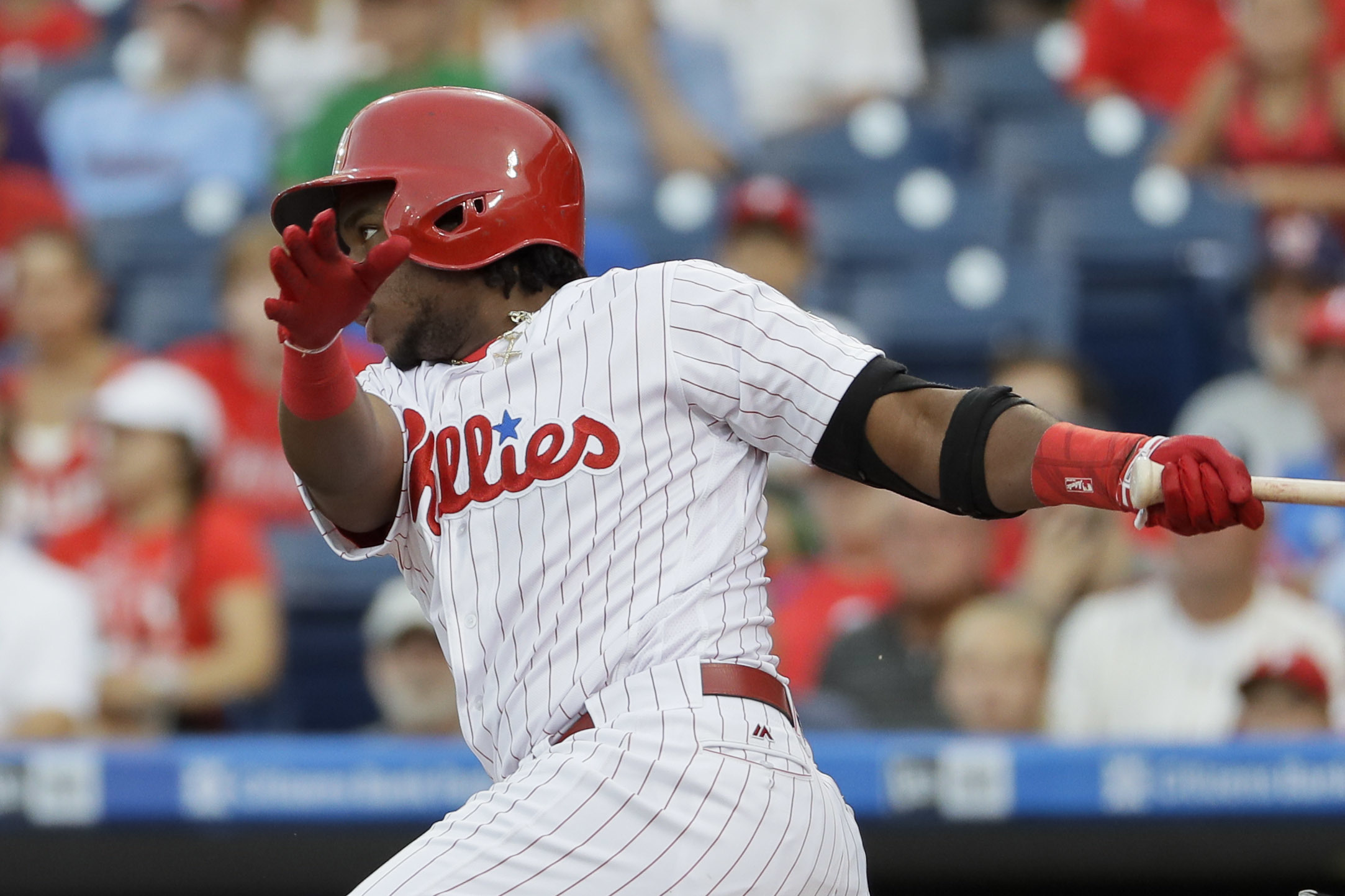Philadelphia Phillies' Maikel Franco follows through after hitting a run-scoring ground-out against Miami Marlins starting pitcher Jose Fernandez during the first inning of a baseball game, Monday, July 18, 2016, in Philadelphia. (AP Photo/Matt Slocum)