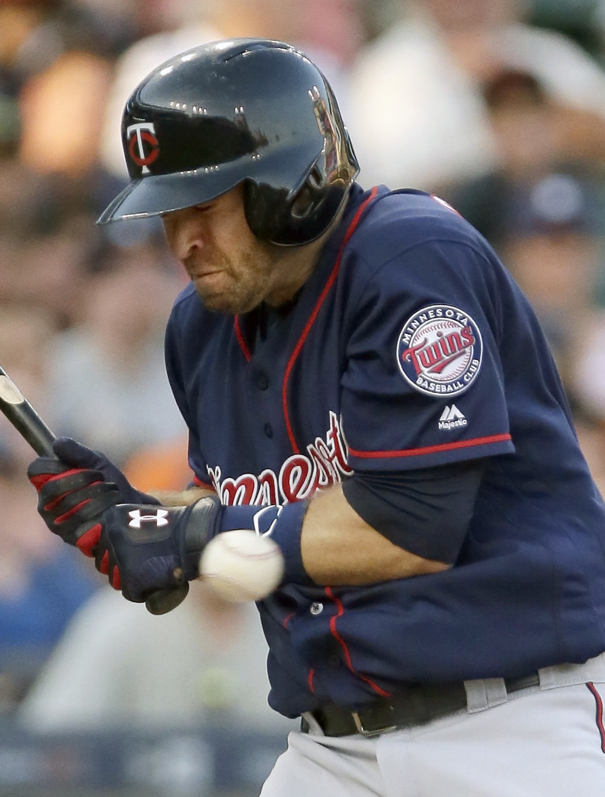 Minnesota Twins' Brian Dozier avoids an inside pitch during the fourth inning of a baseball game against the Detroit Tigers, Monday, July 18, 2016, in Detroit. (AP Photo/Duane Burleson)