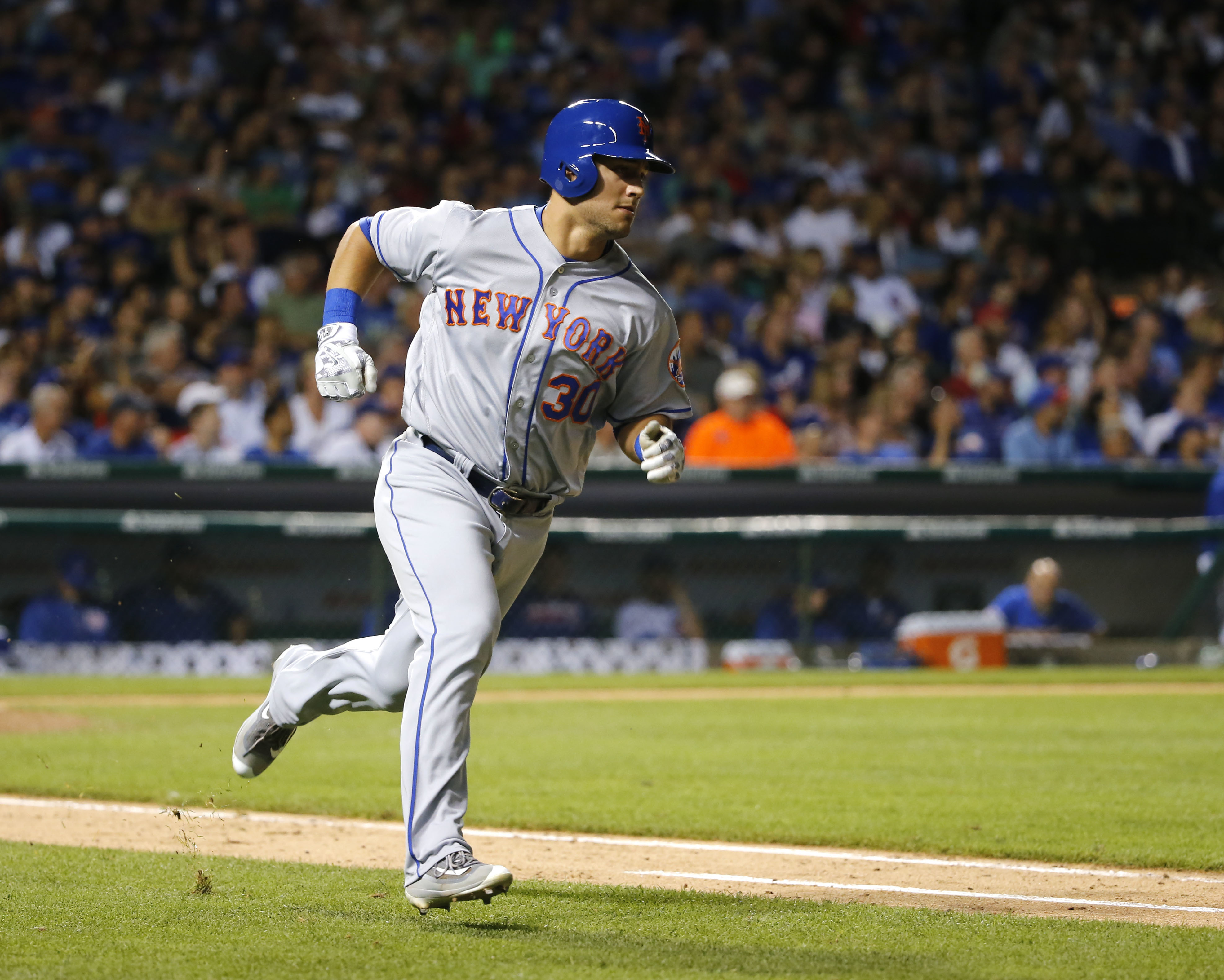 New York Mets' Michael Conforto heads to first after hitting a pinch-hit single during the ninth inning of a baseball game against the Chicago Cubs Monday, July 18, 2016, in Chicago. (AP Photo/Charles Rex Arbogast)