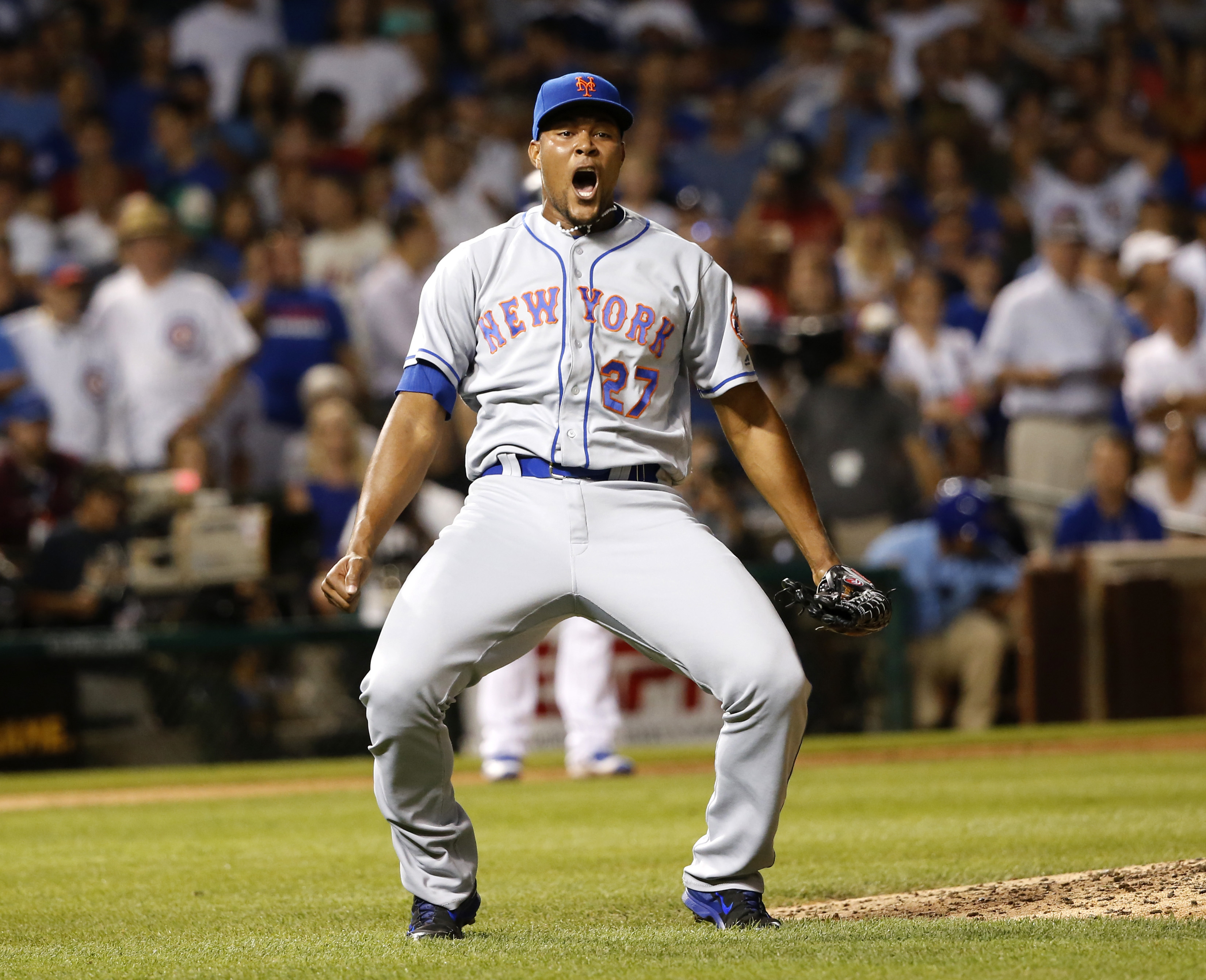 New York Mets relief pitcher Jeurys Familia celebrates the Mets' 2-1 win over the Chicago Cubs after a baseball game Tuesday, July 19, 2016, in Chicago. (AP Photo/Charles Rex Arbogast)