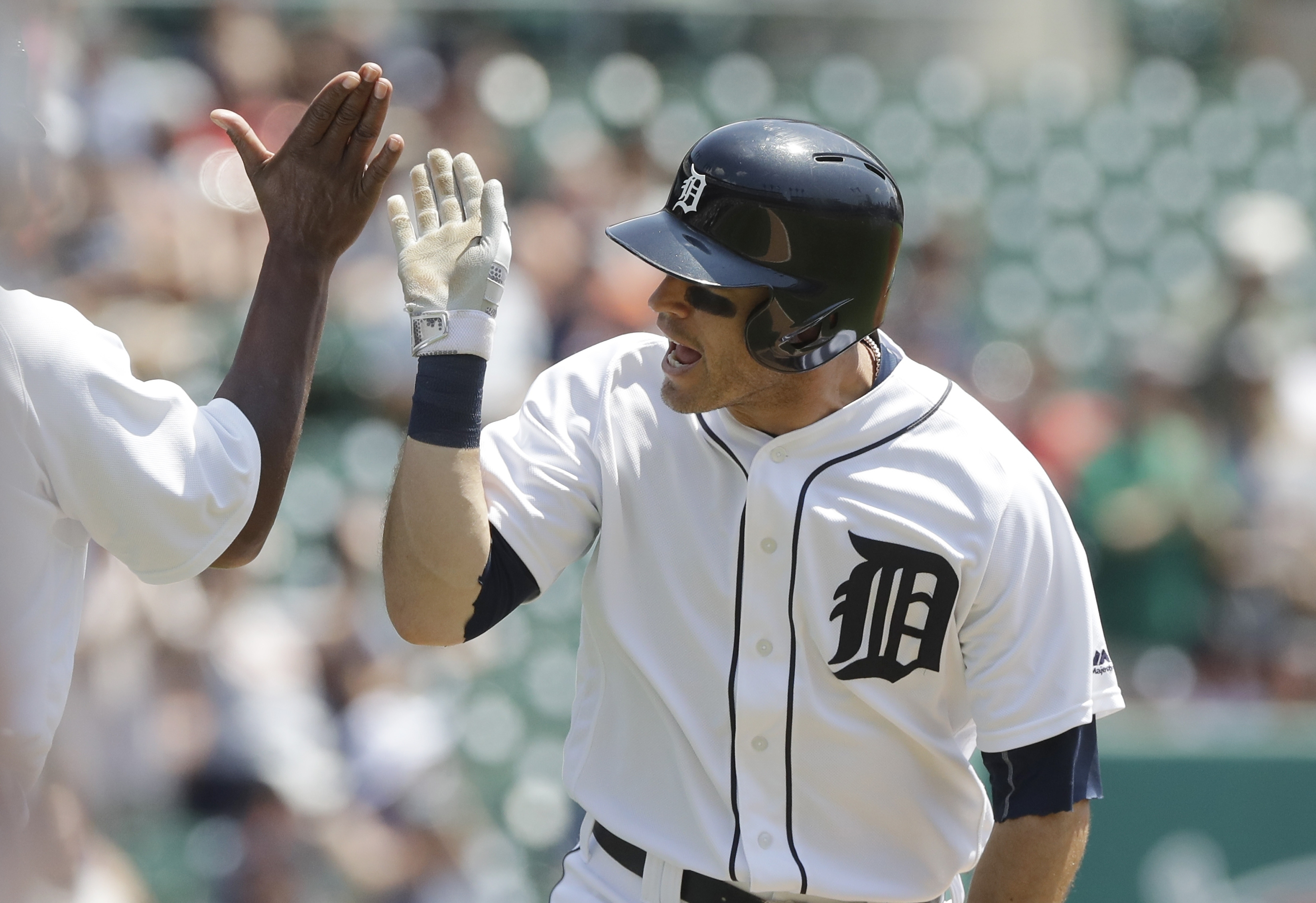 Detroit Tigers second baseman Ian Kinsler gets a high five from third base coach Dave Clark after a solo home run during the first inning of a baseball game against the Minnesota Twins, Wednesday, July 20, 2016 in Detroit. (AP Photo/Carlos Osorio)