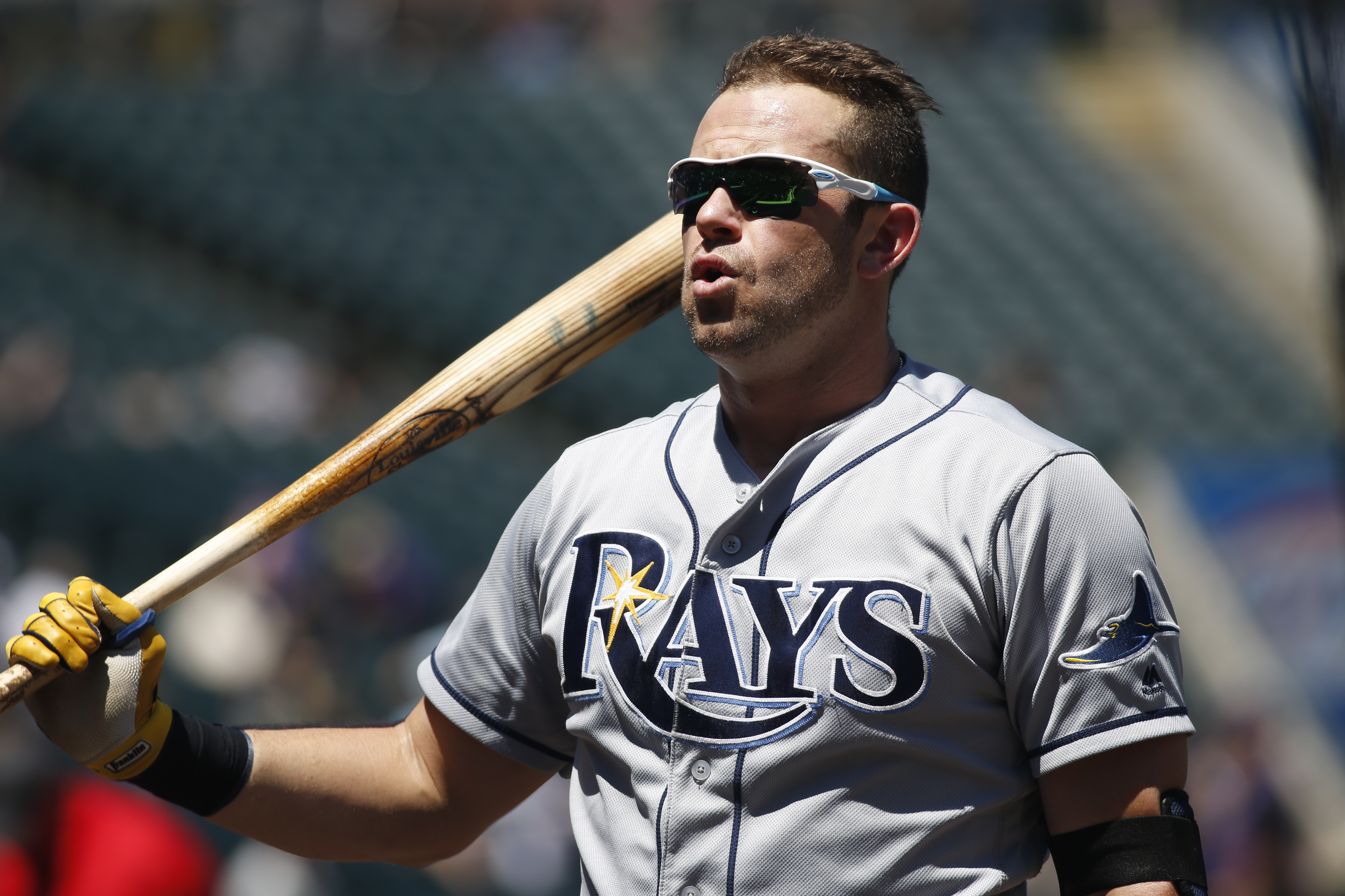 Tampa Bay Rays' Evan Longoria warms up in the on-deck circle as he waits to face Colorado Rockies starting pitcher Jorge De La Rosa in the first inning of a baseball game Wednesday, July 20, 2016 in Denver. (AP Photo/David Zalubowski)