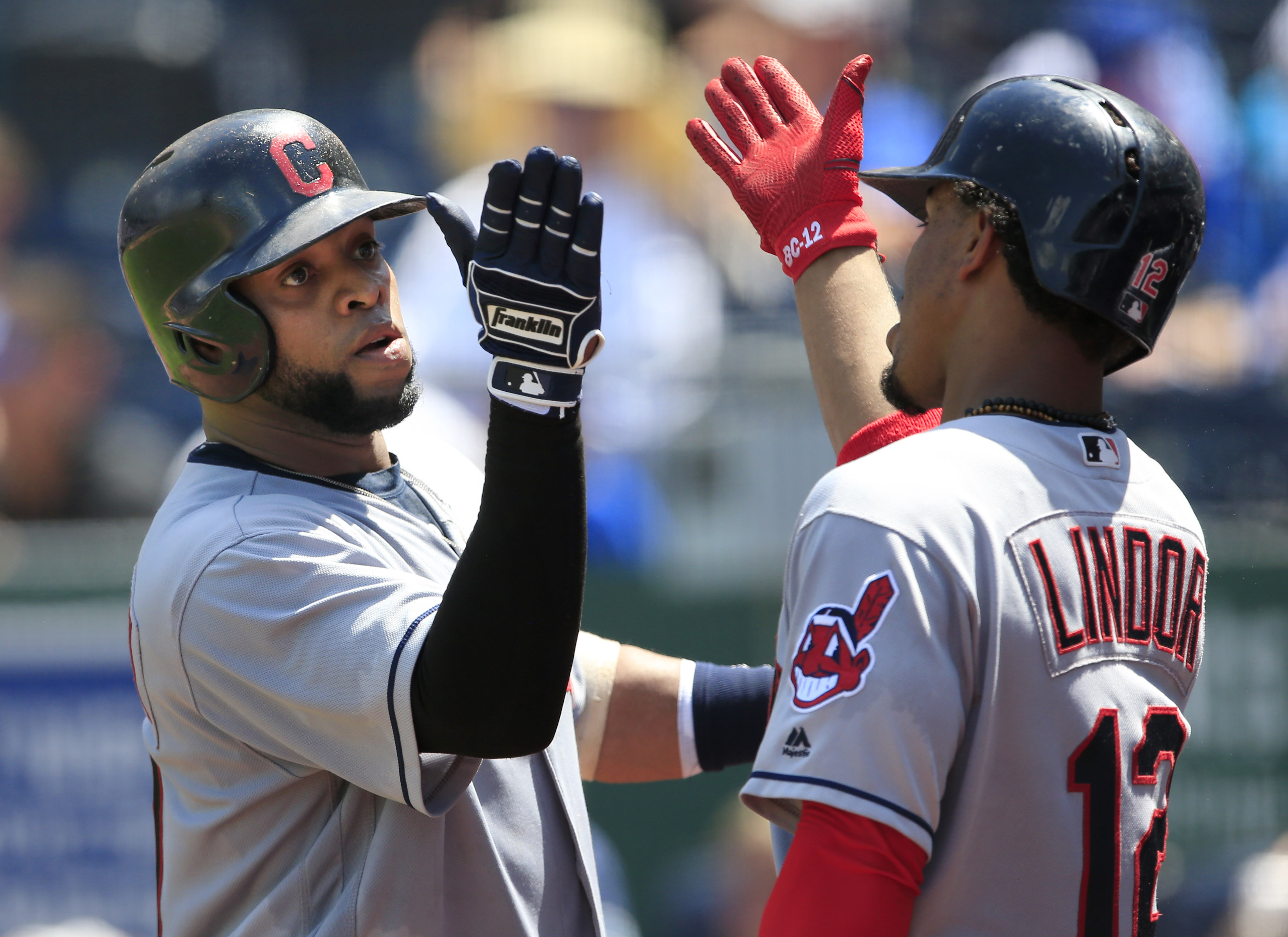 Cleveland Indians designated hitter Carlos Santana, left, celebrates his solo home run with teammate Francisco Lindor (12) during the fifth inning of a baseball game against the Kansas City Royalsnat Kauffman Stadium in Kansas City, Mo., Wednesday, July 2