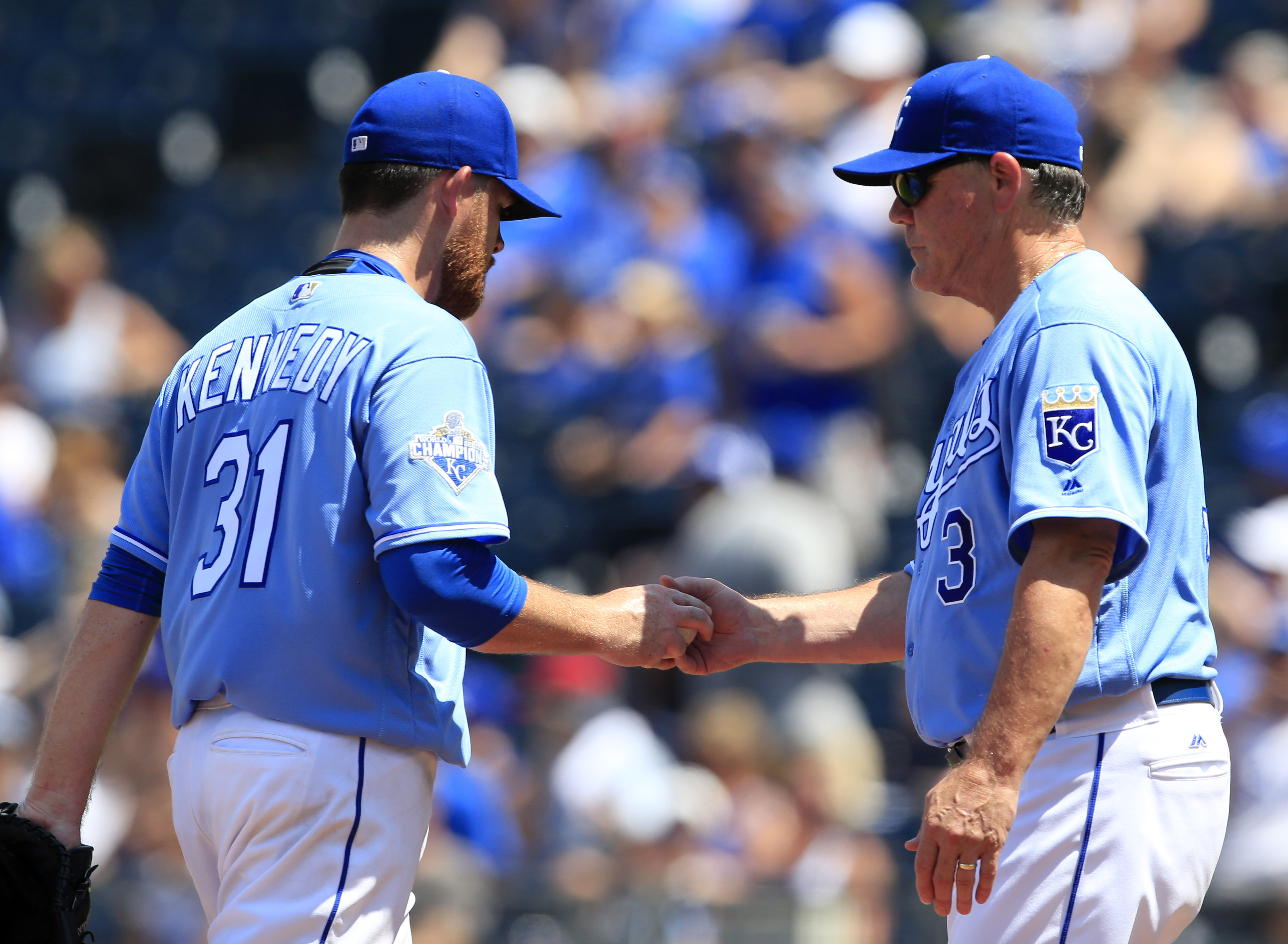 Kansas City Royals manager Ned Yost (3) takes the ball from starting pitcher Ian Kennedy (31) during the fifth inning of a baseball game against the Cleveland Indians at Kauffman Stadium in Kansas City, Mo., Wednesday, July 20, 2016. (AP Photo/Orlin Wagne