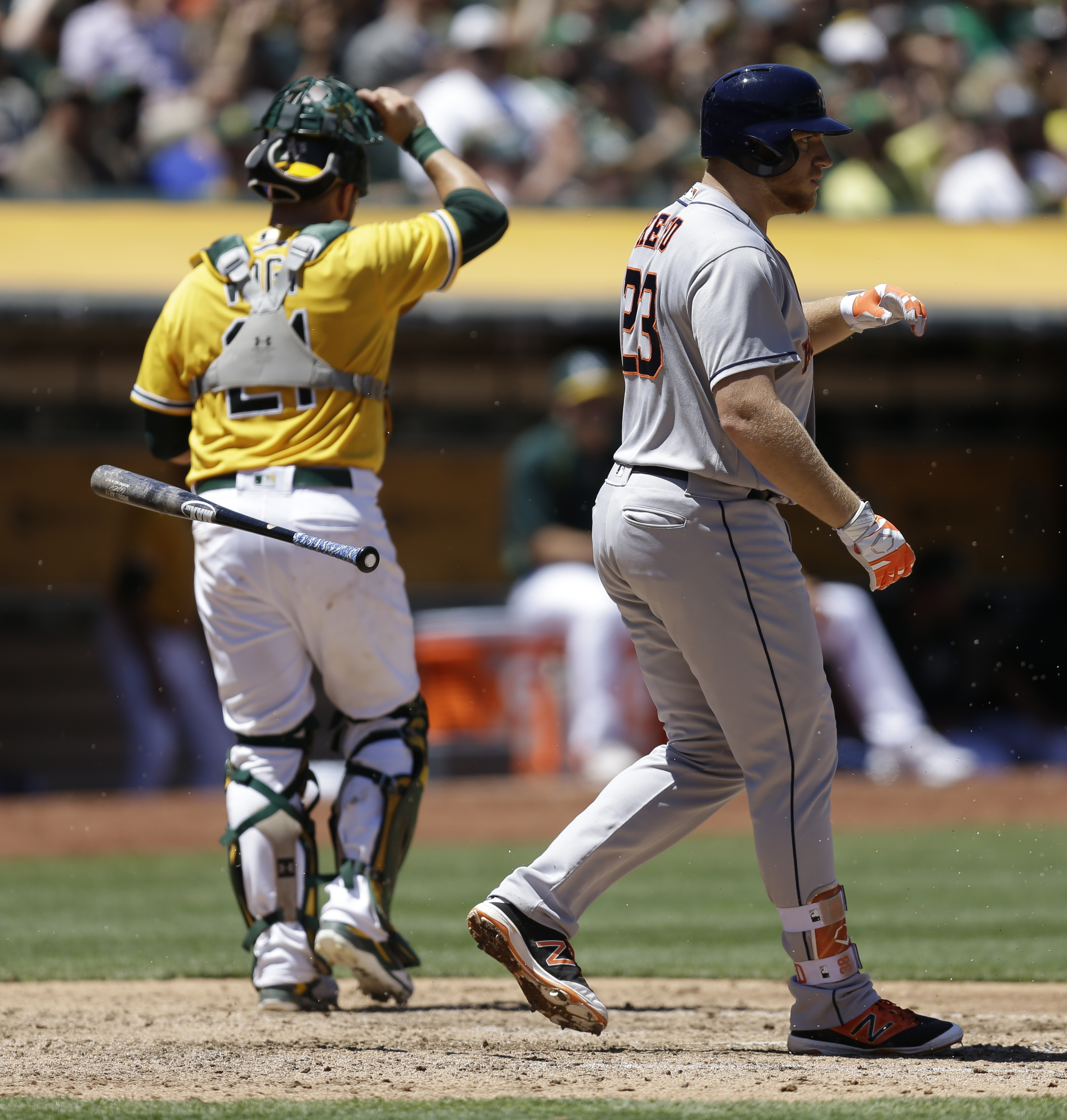 Houston Astros' A.J. Reed, right, throws his bat after striking out to Oakland Athletics pitcher Daniel Mengden in the fifth inning of a baseball game Wednesday, July 20, 2016, in Oakland, Calif. (AP Photo/Ben Margot)