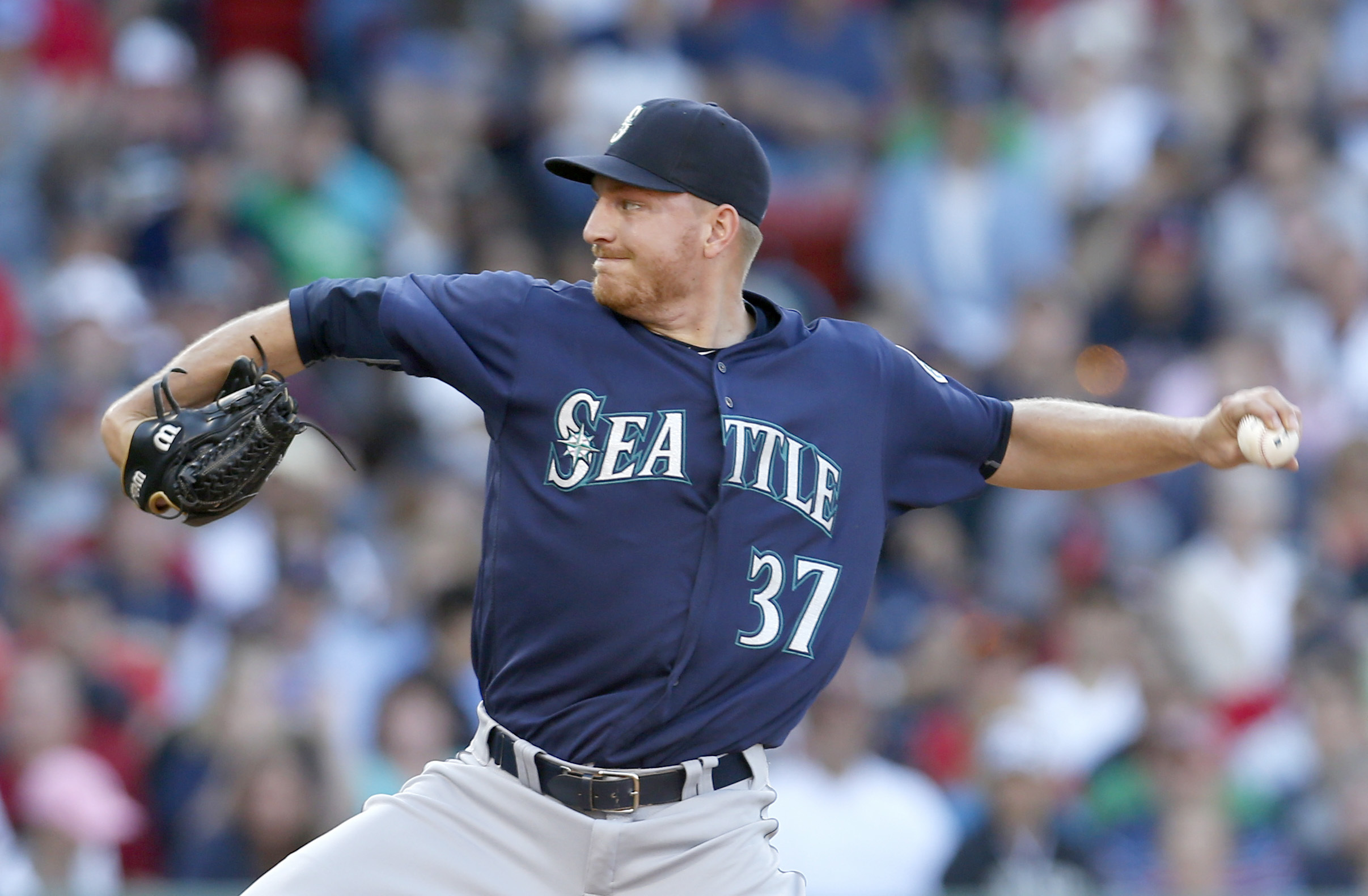 FILE - In this Saturday, June 18, 2016 file photo, Seattle Mariners relief pitcher Mike Montgomery (37) pitches during the sixth inning of a baseball game against the Boston Red Sox at Fenway Park in Boston. The Chicago Cubs added bullpen help by acquirin