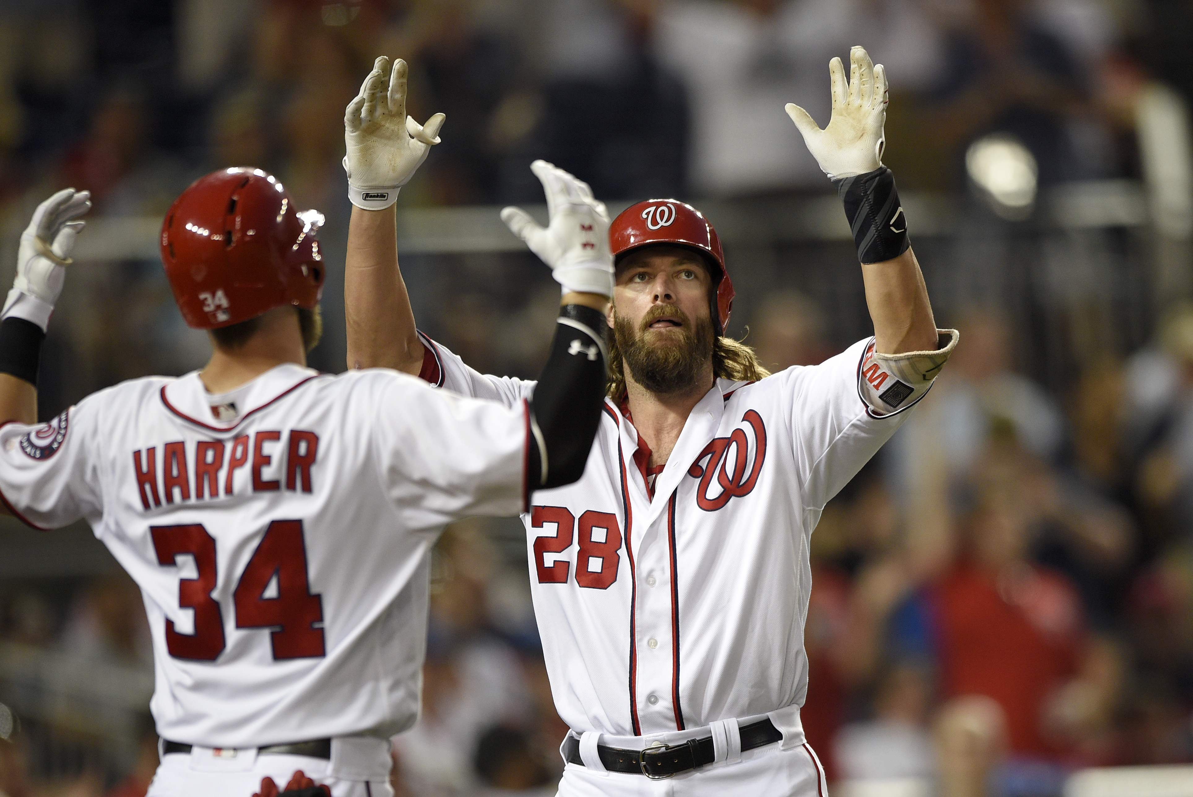 Washington Nationals' Jayson Werth (28) celebrates his home run with Bryce Harper (34) during the fifth inning of a baseball game against the Los Angeles Dodgers, Wednesday, July 20, 2016, in Washington. (AP Photo/Nick Wass)