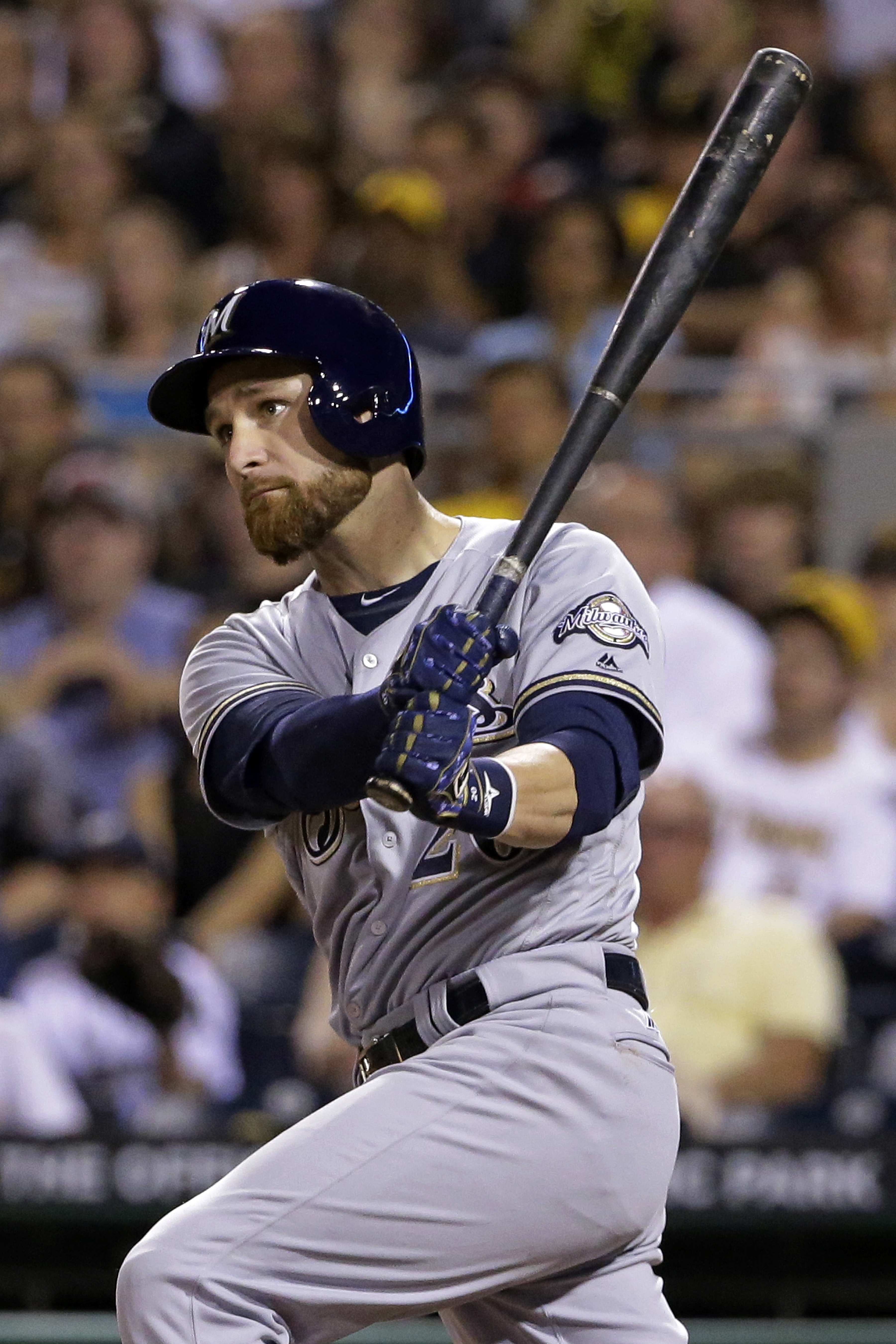 Milwaukee Brewers' Jonathan Lucroy drives in two runs with a single off Pittsburgh Pirates relief pitcher A.J. Schugel in the sixth inning of a baseball game in Pittsburgh, Wednesday, July 20, 2016. (AP Photo/Gene J. Puskar)