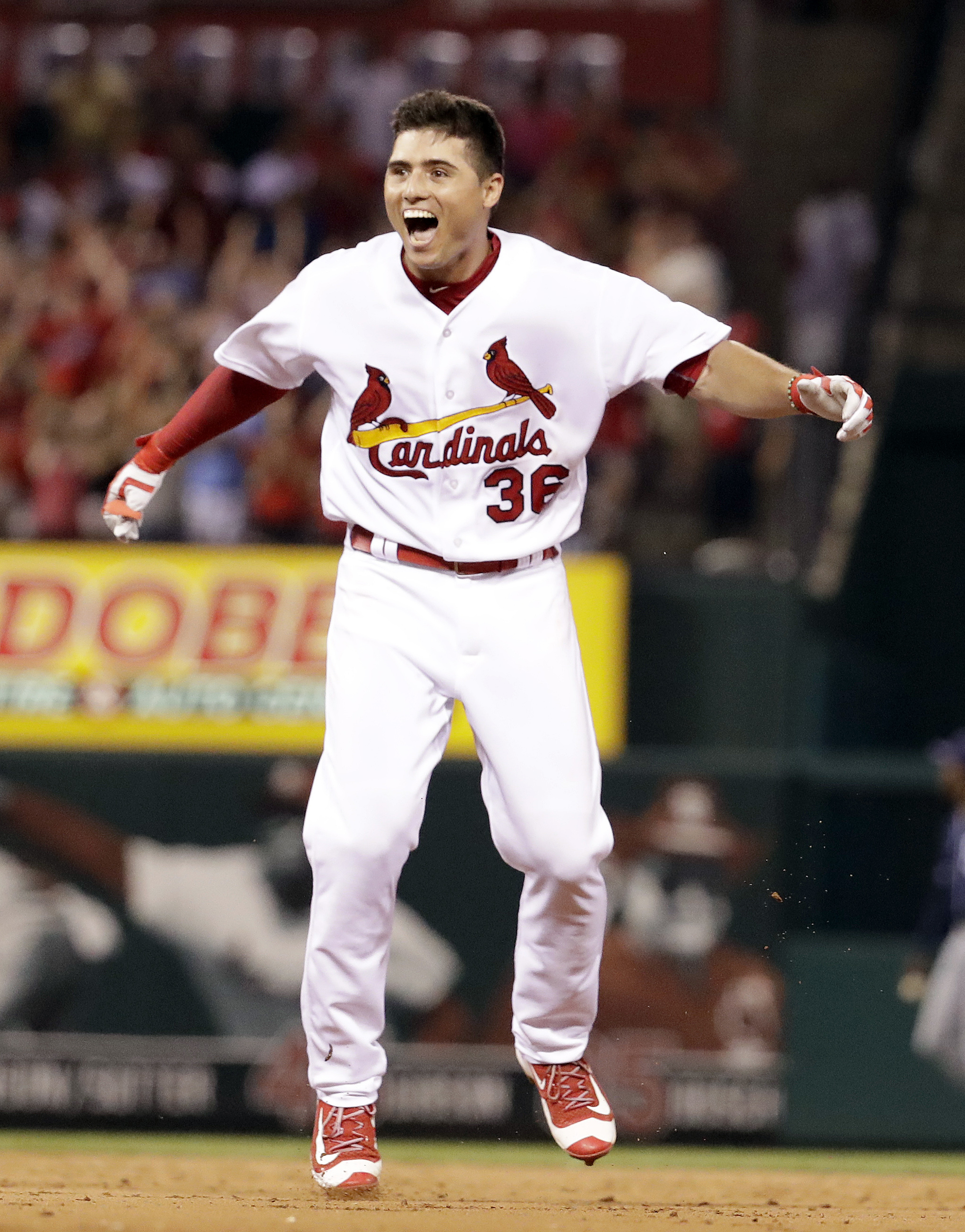 St. Louis Cardinals' Aledmys Diaz celebrates after hitting a walk-off single during the ninth inning of a baseball game against the San Diego Padres Thursday, July 21, 2016, in St. Louis. The Cardinals won 6-5. (AP Photo/Jeff Roberson)