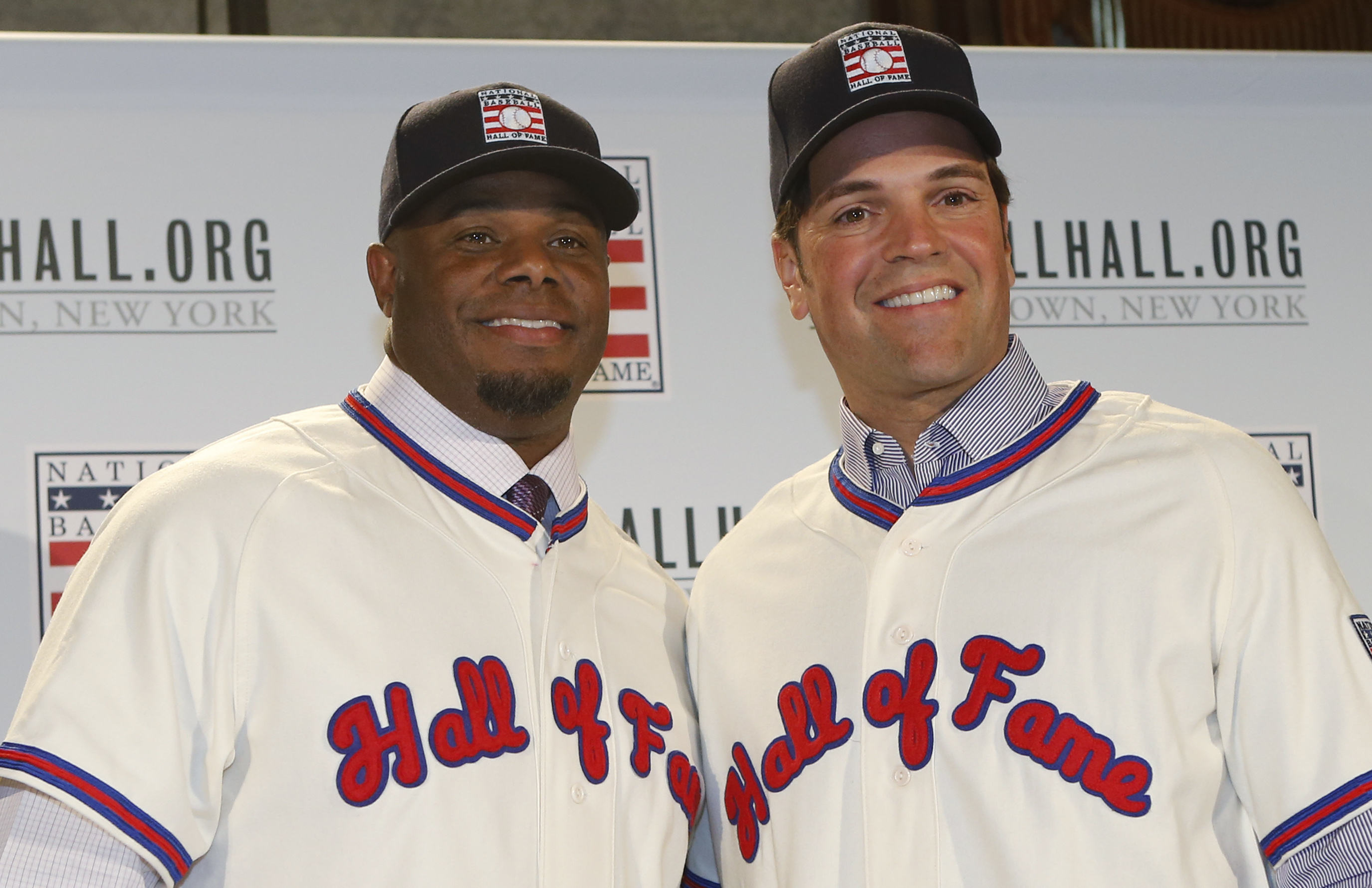 FILE - In this Jan. 7, 2016, file photo, Ken Griffey Jr., left, poses for a photograph with Mike Piazza at a press conference announcing they are both elected into the 2016 National Baseball Hall of Fame, in New York. The Seattle Mariners made Ken Griffey
