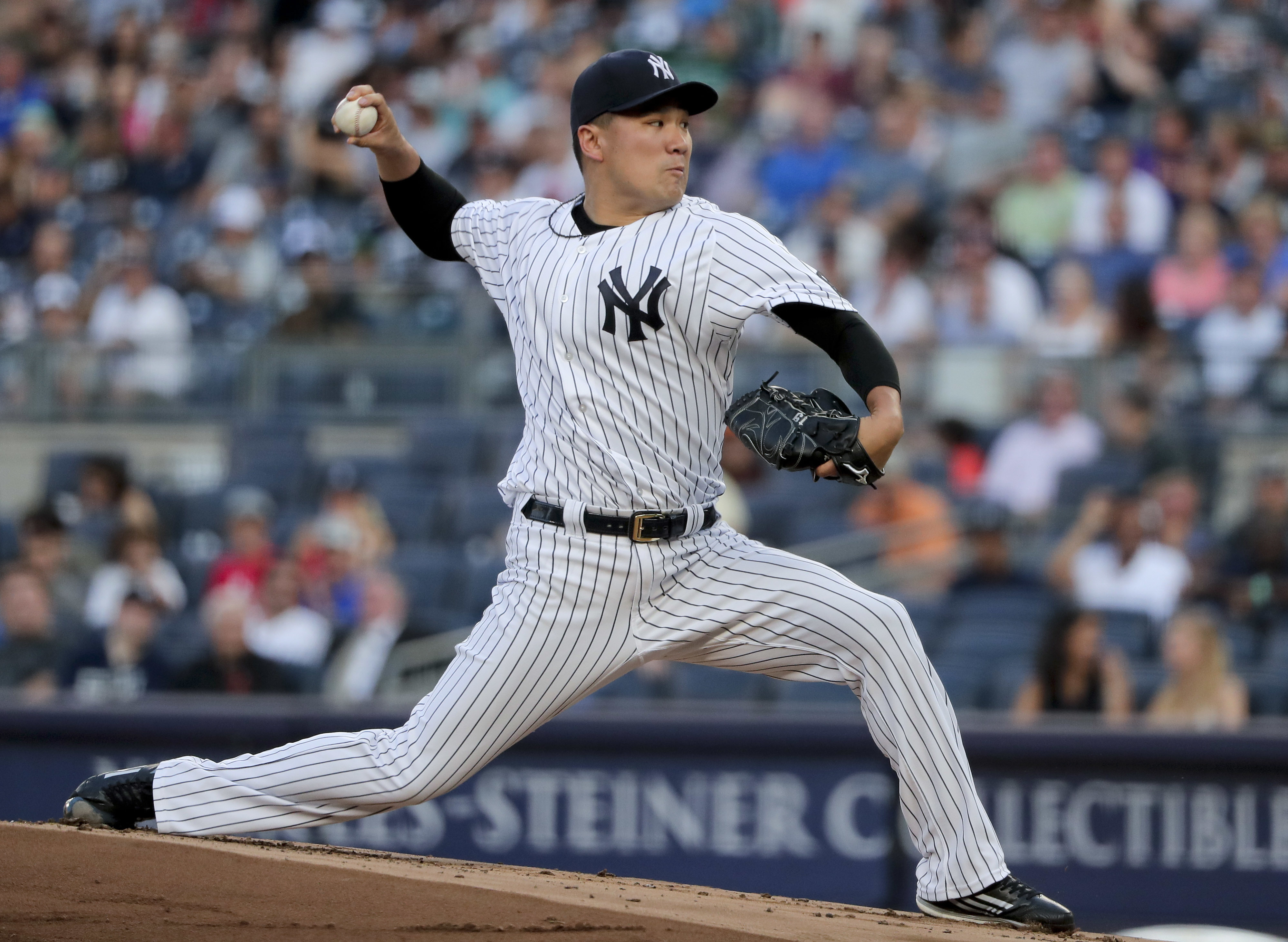 New York Yankees starting pitcher Masahiro Tanaka delivers against the San Francisco Giants during the first inning of a baseball game Friday, July 22, 2016, in New York. (AP Photo/Julie Jacobson)