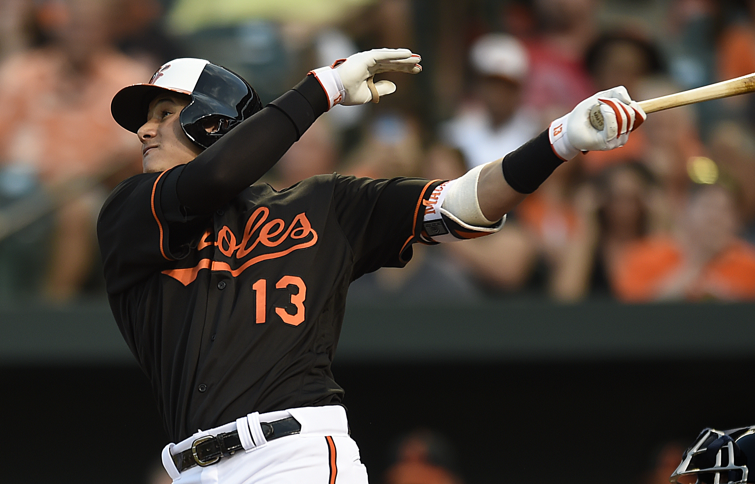 Baltimore Orioles' Manny Machado follows through on a solo home run against the Cleveland Indians in the third inning of a baseball game, Friday, July 22, 2016, in Baltimore. (AP Photo/Gail Burton)