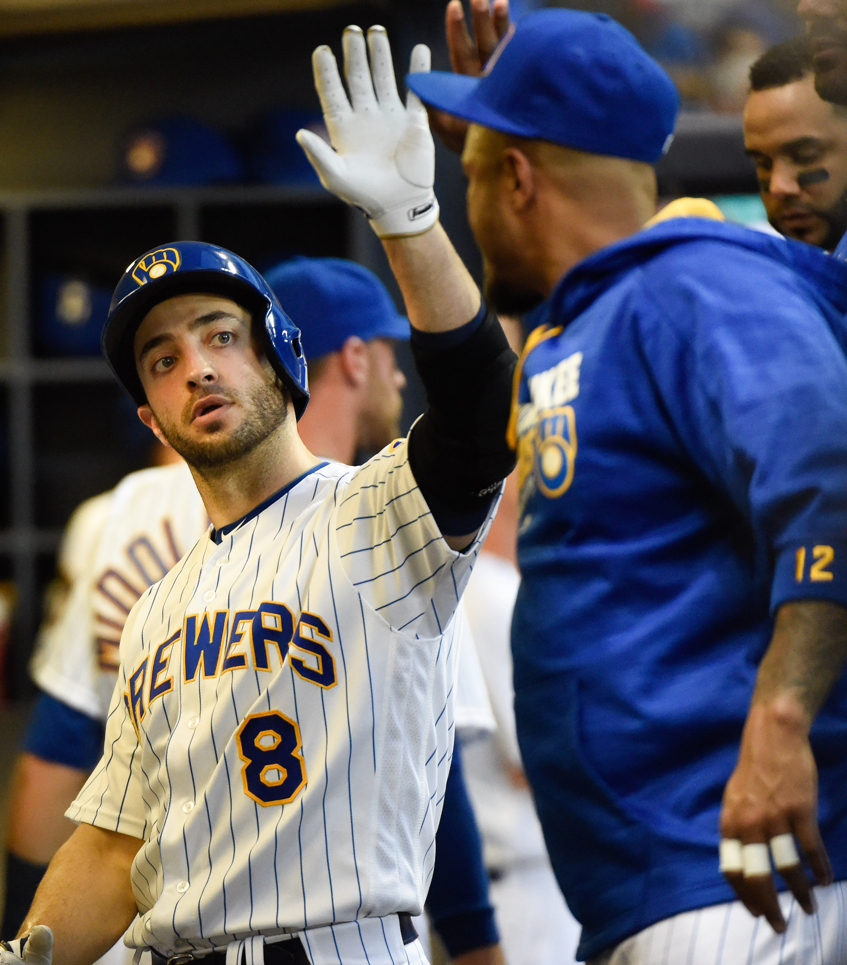 Milwaukee Brewers' Ryan Braun is greeted in the dugout after hitting a solo home run off Chicago Cubs starting pitcher Jason Hammel during the fourth inning of a baseball game Friday, July 22, 2016, in Milwaukee. (AP Photo/Benny Sieu)
