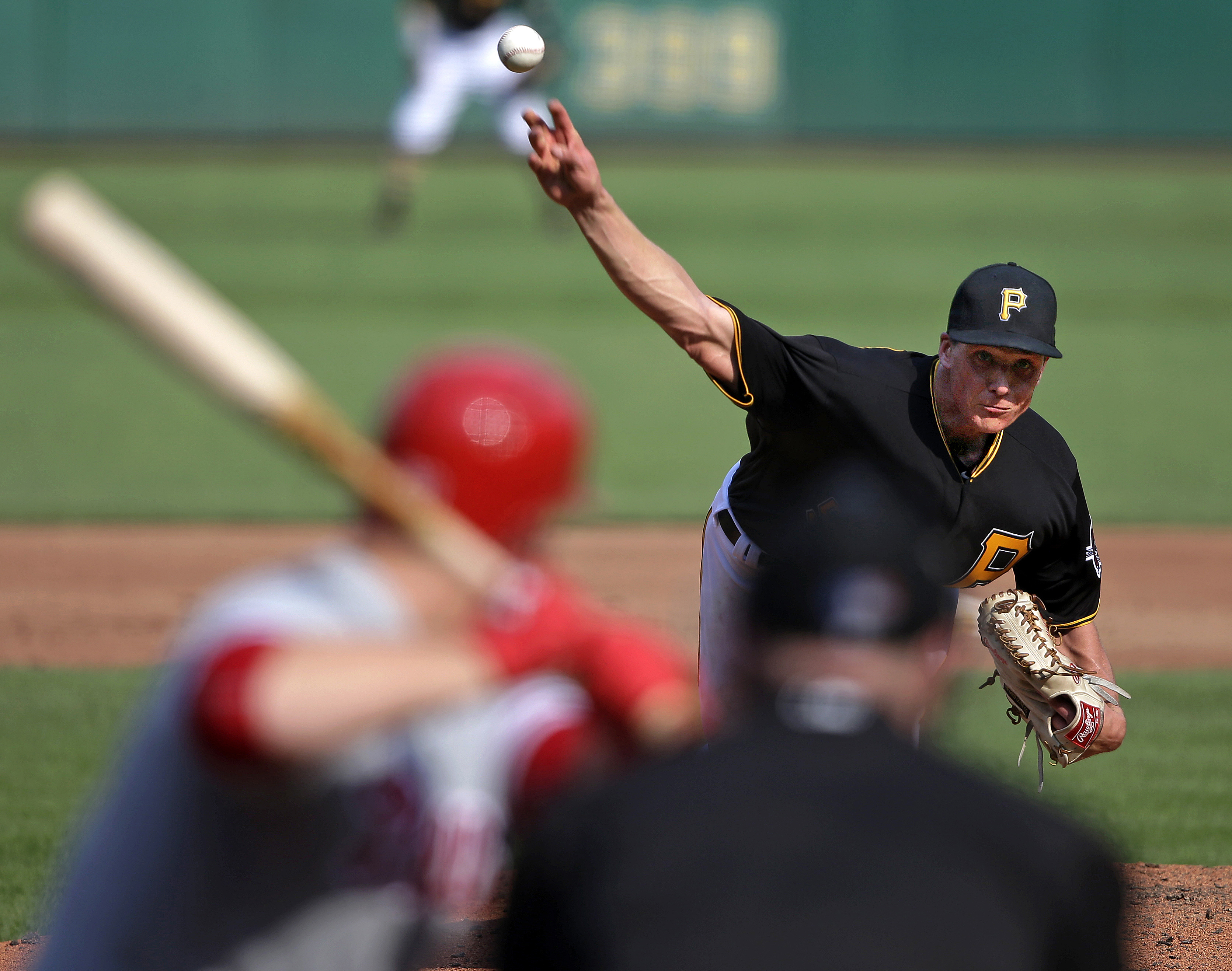 Pittsburgh Pirates starter Tyler Glasnow, right, delivers a pitch that hit Philadelphia Phillies' Cameron Rupp, left, on the helmet in the third inning of a baseball game in Pittsburgh, Saturday, July 23, 2016. (AP Photo/Gene J. Puskar)