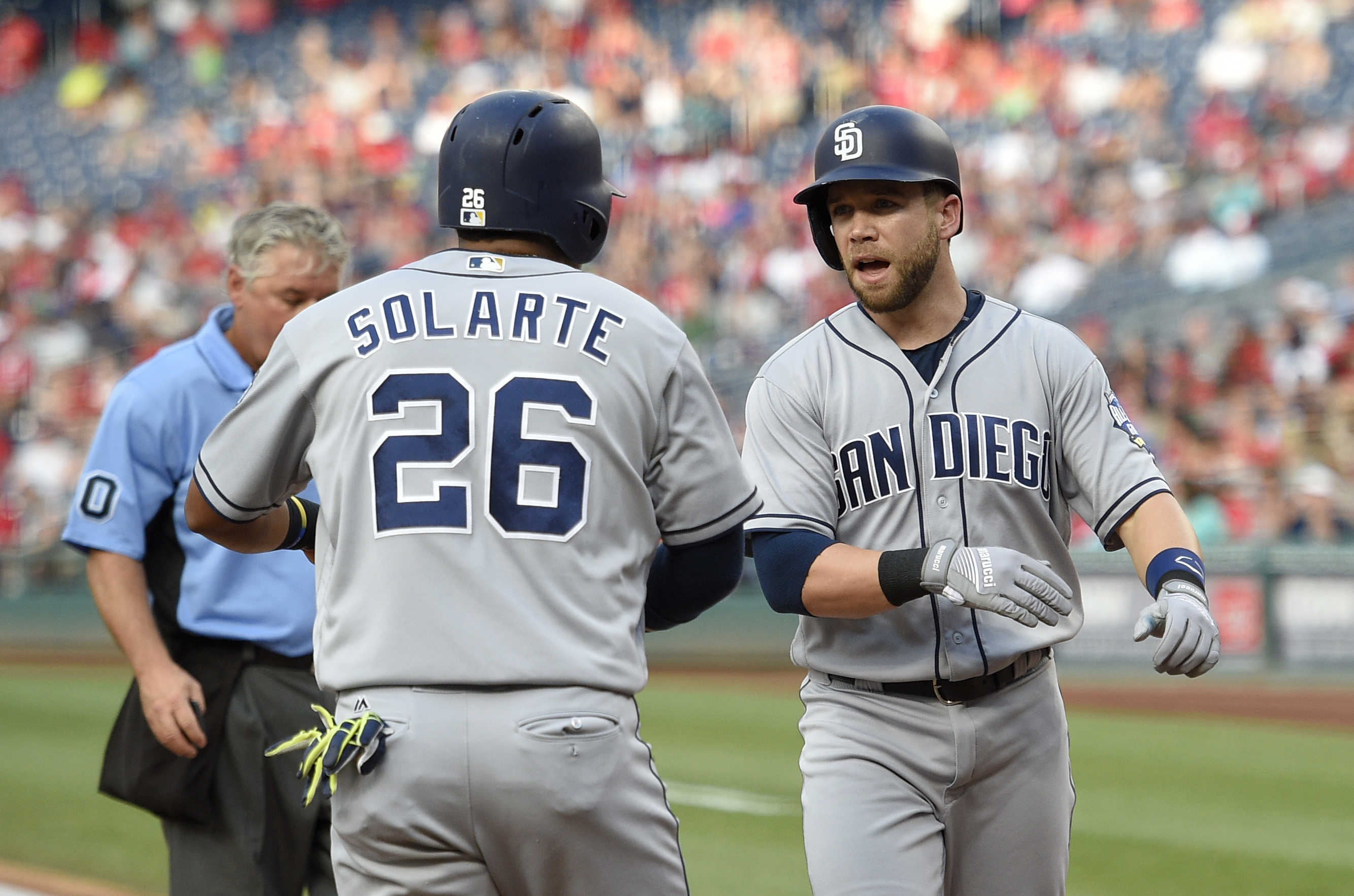 San Diego Padres second baseman Ryan Schimpf, right, celebrates his two-run home run with Yangervis Solarte (26) during the second inning of a baseball game against the Washington Nationals, Saturday, July 23, 2016, in Washington. (AP Photo/Nick Wass)