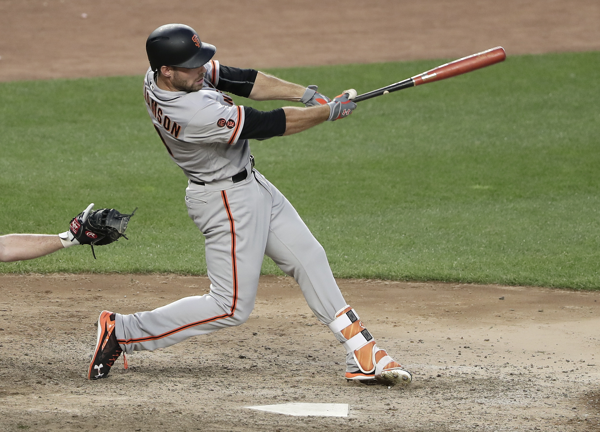 San Francisco Giants' Mac Williamson connects for an RBI-base hit against the New York Yankees during the twelfth inning of a baseball game, Saturday, July 23, 2016, in New York. Giants' Trevor Brown scored on the play. (AP Photo/Julie Jacobson)