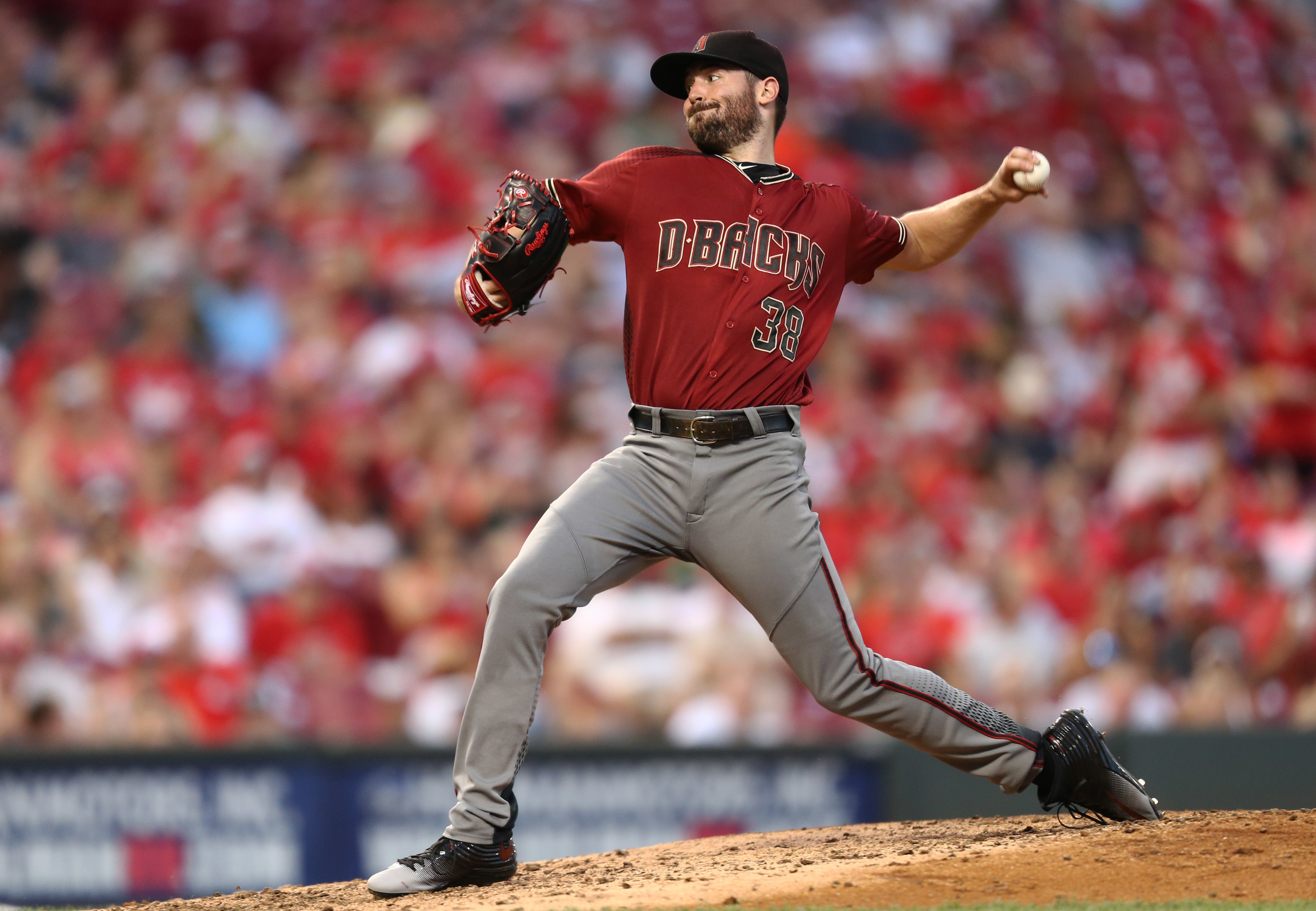 Arizona Diamondbacks starting pitcher Robbie Ray throws in the fourth inning of a baseball game against the Cincinnati Reds, Saturday, July 23, 2016, in Cincinnati. (AP Photo/Aaron Doster)