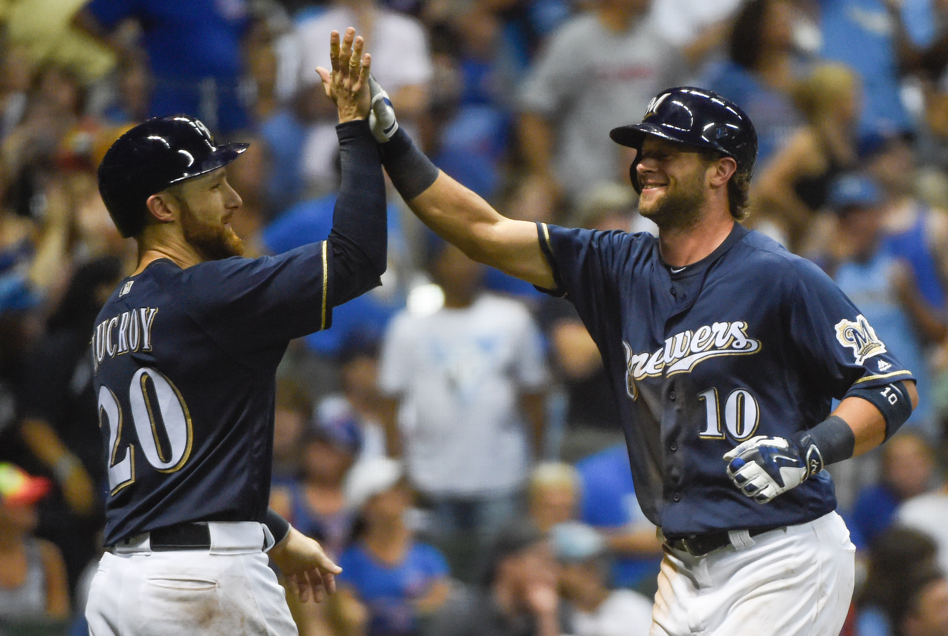 Milwaukee Brewers' Kirk Nieuwenhuis, right, is greeted by Jonathan Lucroy after hitting a three-run home run off Chicago Cubs pitcher Mike Montgomery during the eighth inning of a baseball game Saturday, July 23, 2016, in Milwaukee. Milwaukee won 6-1. (AP