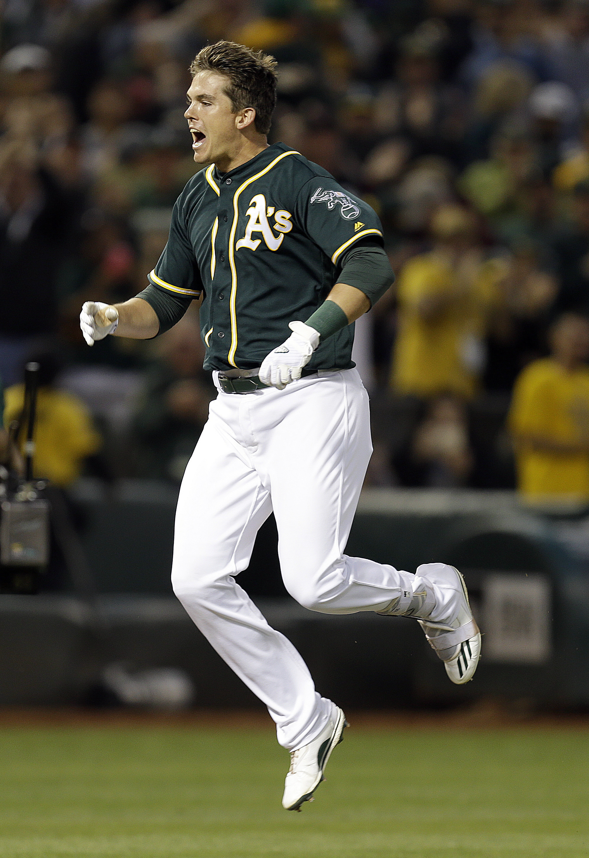 Oakland Athletics' Ryon Healy celebrates after hitting the game-winning home run off Tampa Bay Rays' Alex Colome during the ninth inning of a baseball game Saturday, July 23, 2016, in Oakland, Calif. The A's won 4-3. (AP Photo/Ben Margot)