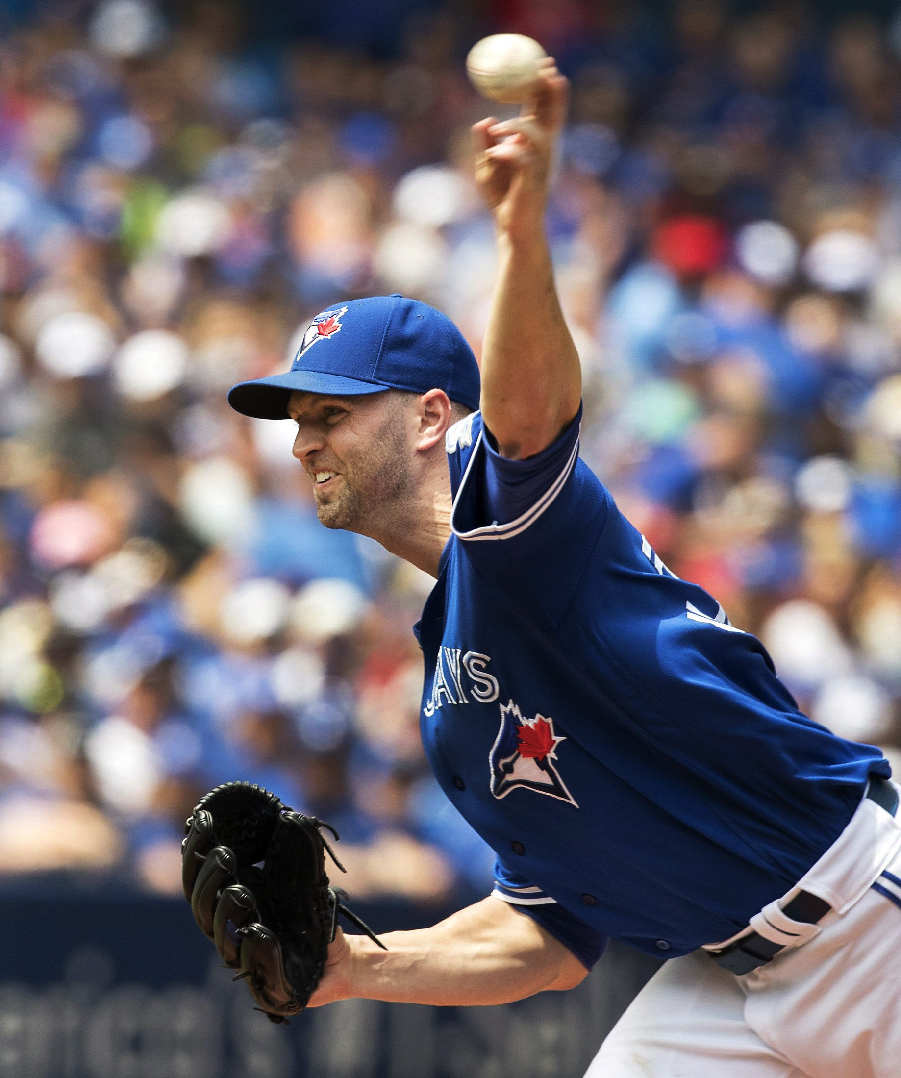 Toronto Blue Jays starting pitcher J.A. Happ throws to a Seattle Mariners batter during the first inning of a baseball game in Toronto on Sunday July 24, 2016. (Fred Thornhill/The Canadian Press via AP)