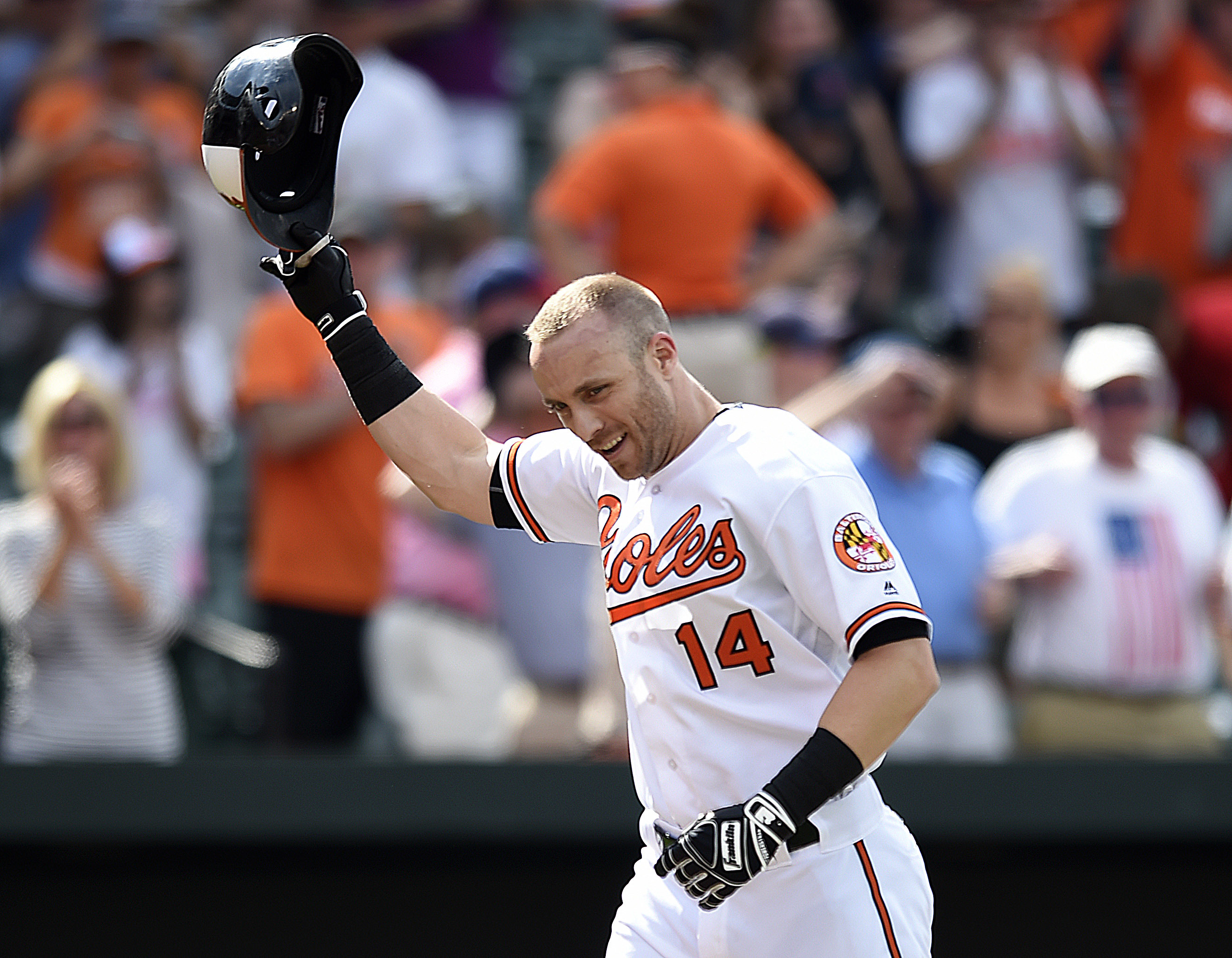Baltimore Orioles' Nolan Reimold tips his helmet after hitting a walk-off two-run home run against the Cleveland Indians during a baseball game Sunday, July 24, 2016 in Baltimore. The Orioles won 5-3. (AP Photo/Gail Burton)