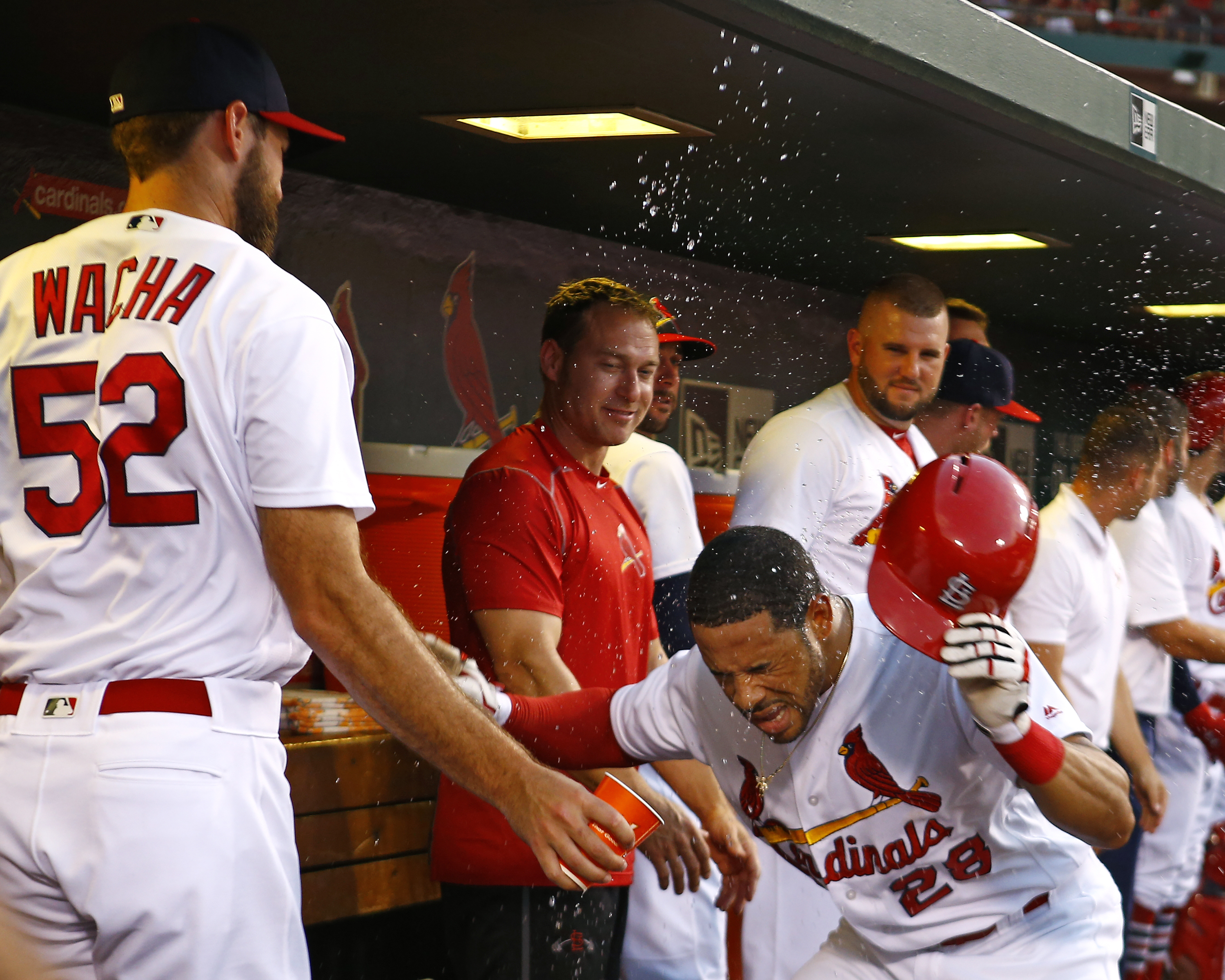 St. Louis Cardinals' Tommy Pham, right, is splashed with water by Michael Wacha after hitting a two-run home run off of Los Angeles Dodgers starting pitcher Scott Kazmir during the second inning of a baseball game Sunday, July 24, 2016, in St. Louis. (AP