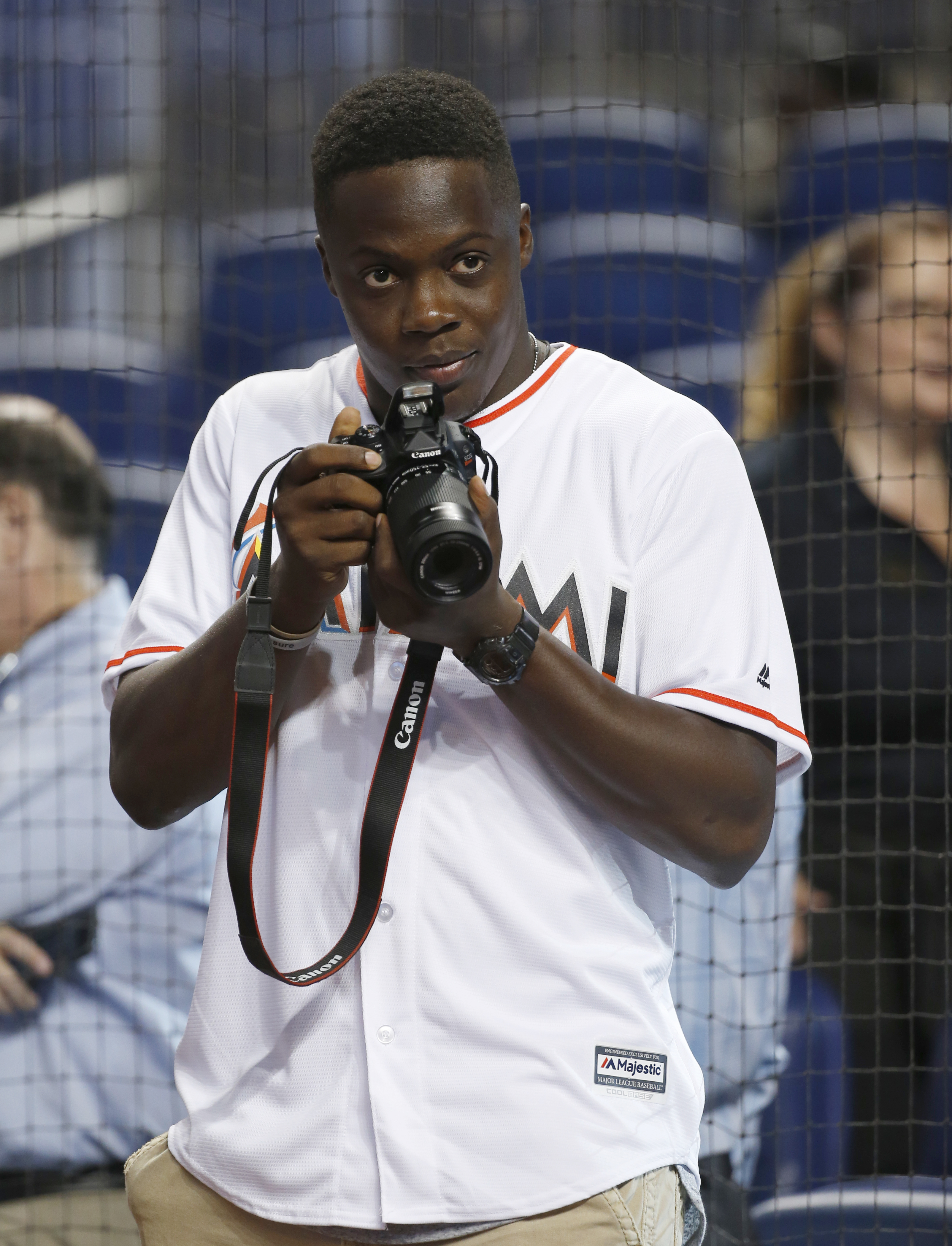 Minnesota Vikings quarterback Teddy Bridgewater takes photos before throwing out a ceremonial first pitch before the start of a baseball game between the Miami Marlins and the Philadelphia Phillies, Monday, July 25, 2016, in Miami. (AP Photo/Wilfredo Lee)