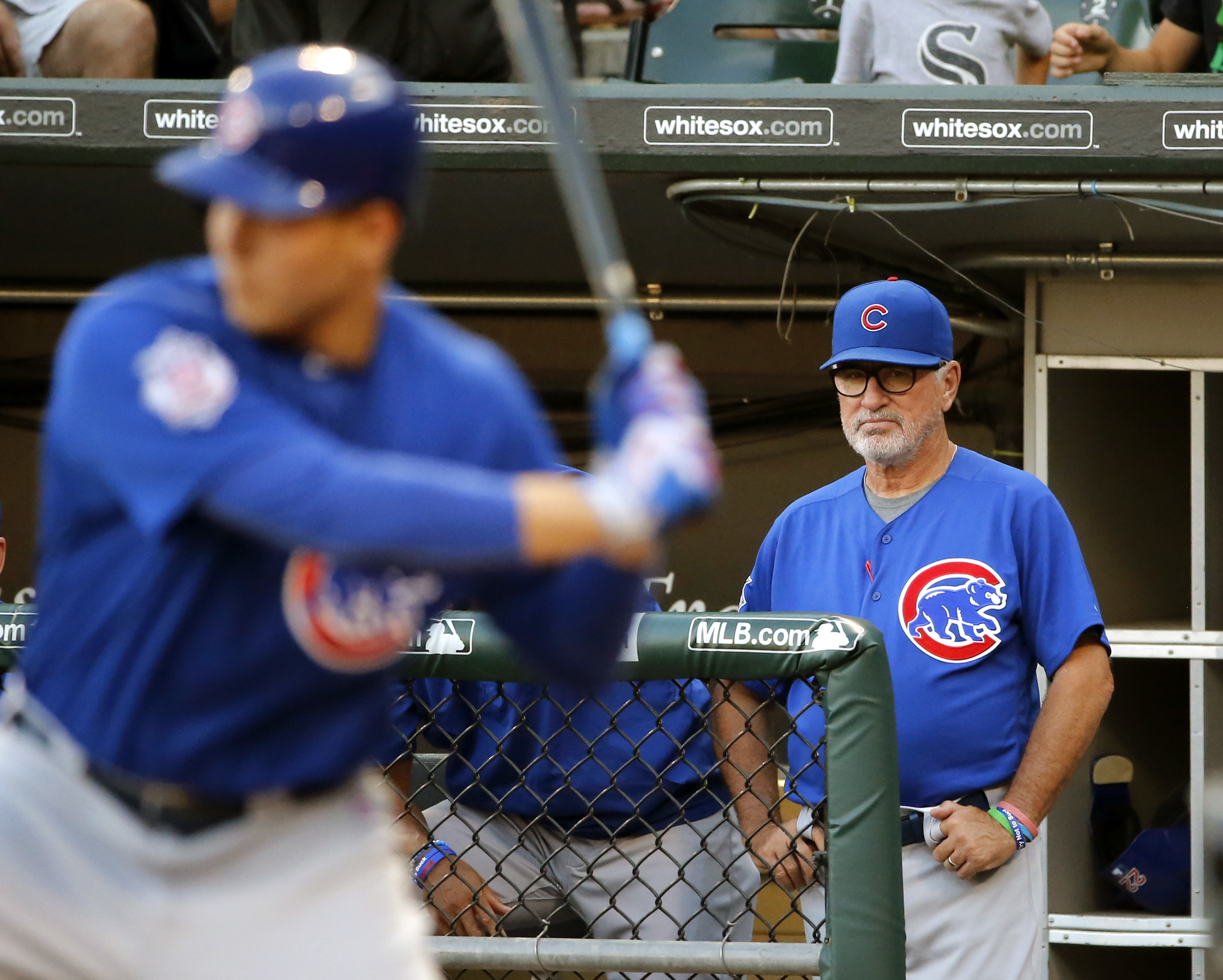 Chicago Cubs manager Joe Maddon, right, watches Anthony Rizzo at bat during the first inning of a baseball game against the Chicago White Sox Monday, July 25, 2016, in Chicago. (AP Photo/Charles Rex Arbogast)