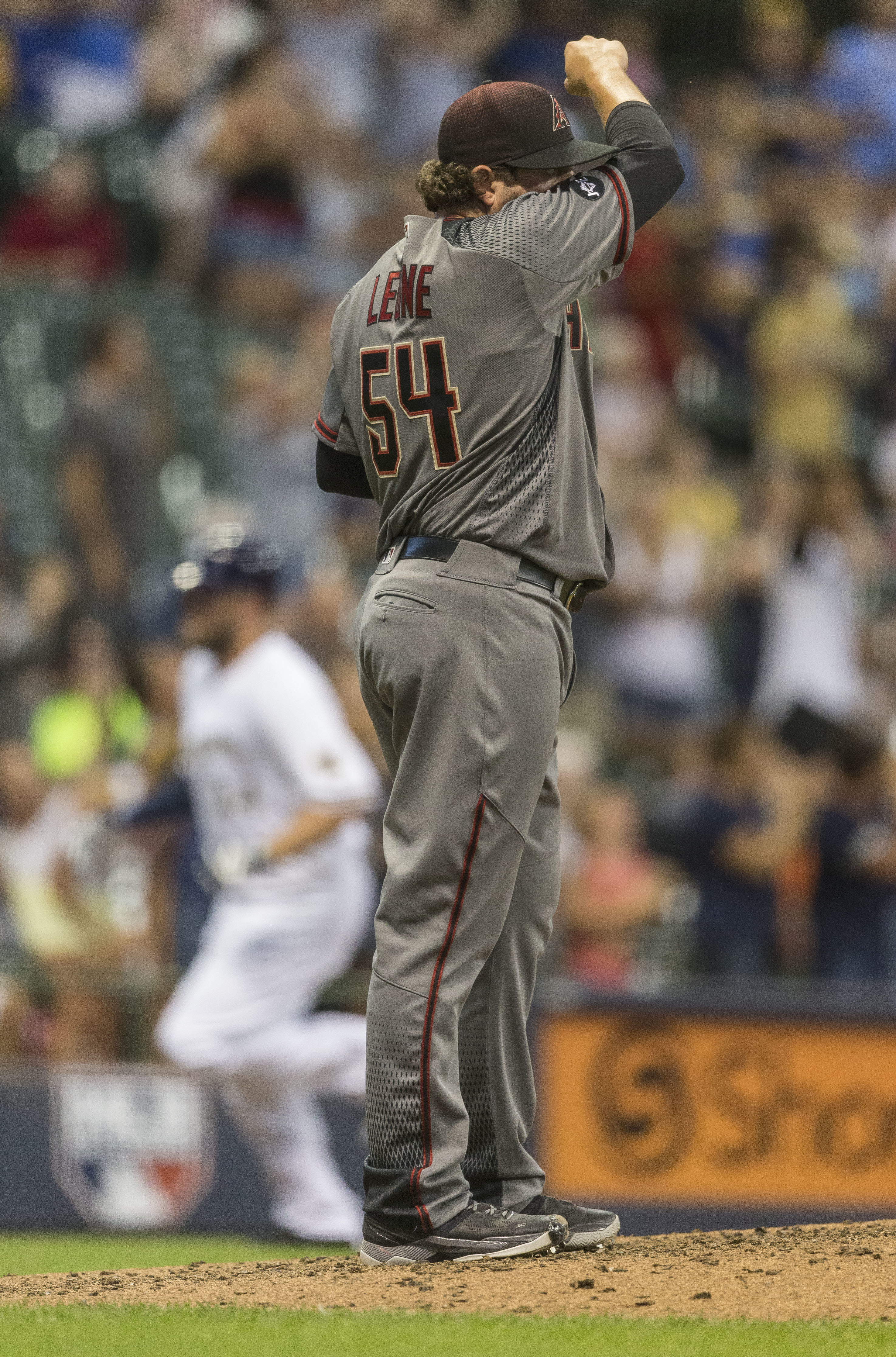 Milwaukee Brewers' Andy Wilkins rounds third after hitting a solo home run off of Arizona Diamondbacks' Dominic Leone during the sixth inning of a baseball game Monday, July 25, 2016, in Milwaukee. (AP Photo/Tom Lynn)