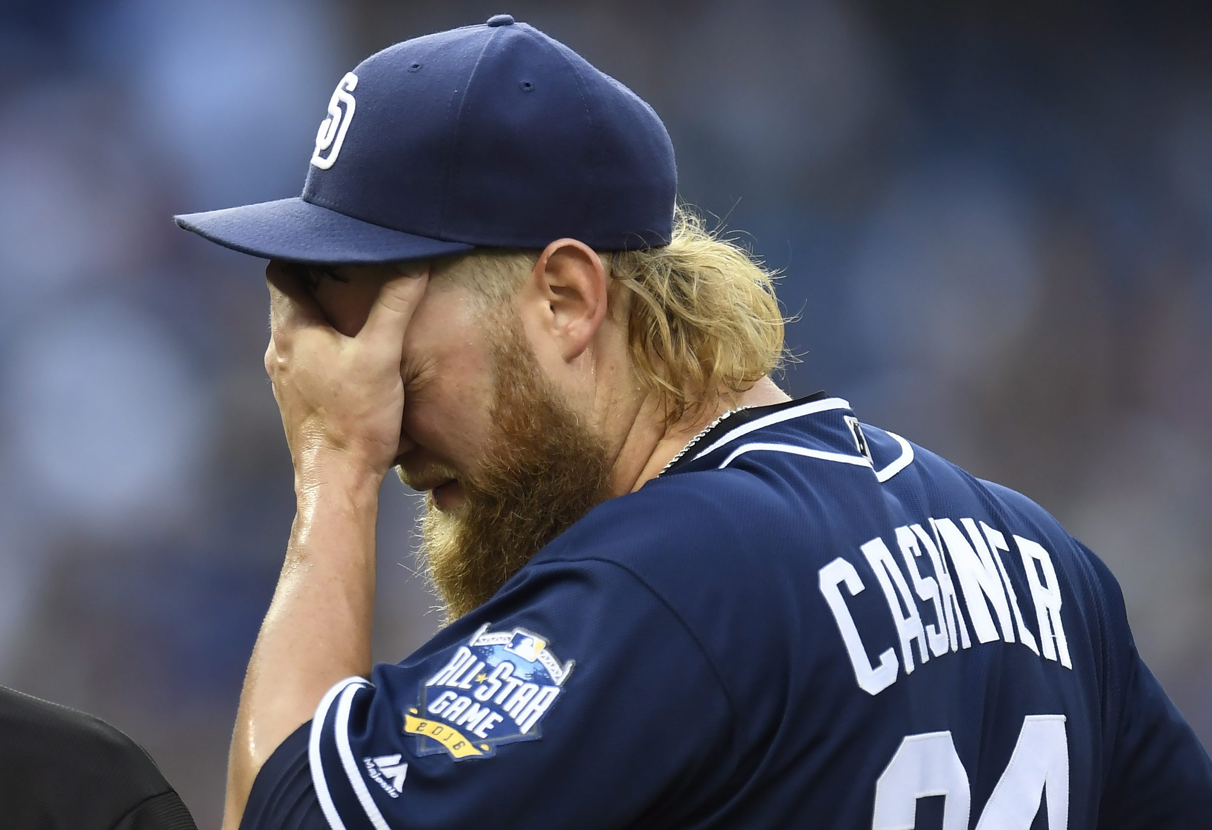 San Diego Padres starting pitcher Andrew Cashner reacts on the mound during the first inning of the team's baseball game against the Toronto Blue Jays on Tuesday, July 26, 2016, in Toronto. (Frank Gunn/The Canadian Press via AP)