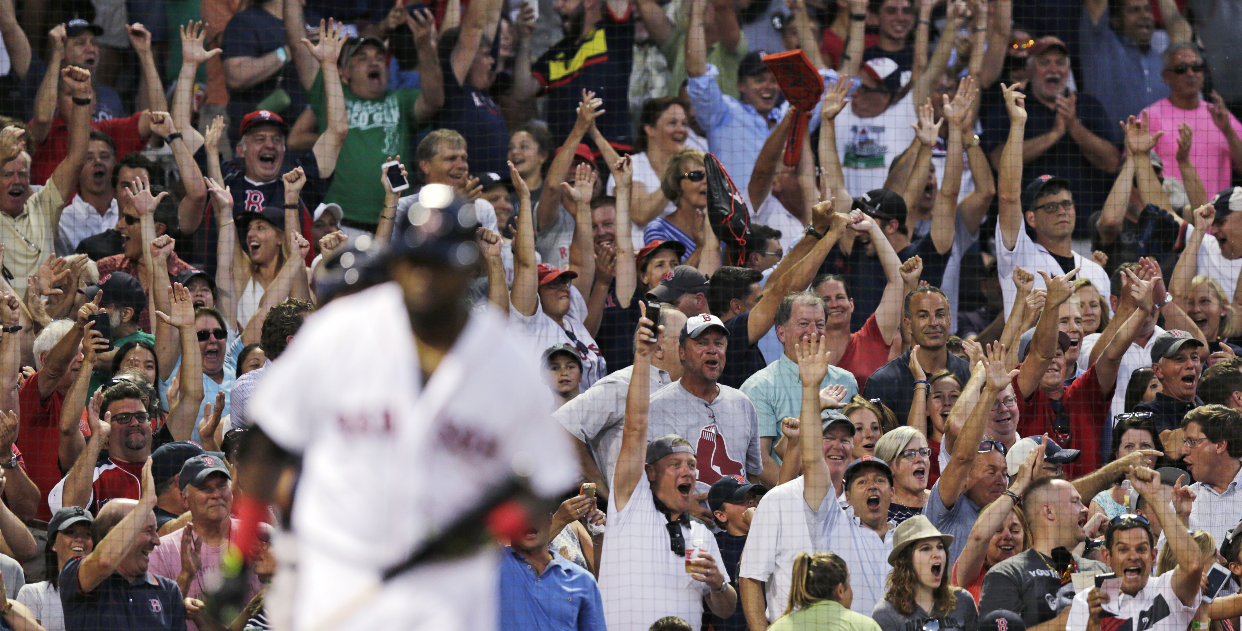 Fans celebrate after a three-run home run by Boston Red Sox designated hitter David Ortiz off Detroit Tigers starting pitcher Mike Pelfrey during the third inning of a baseball game at Fenway Park, Tuesday, July 26, 2016, in Boston. (AP Photo/Charles Krup