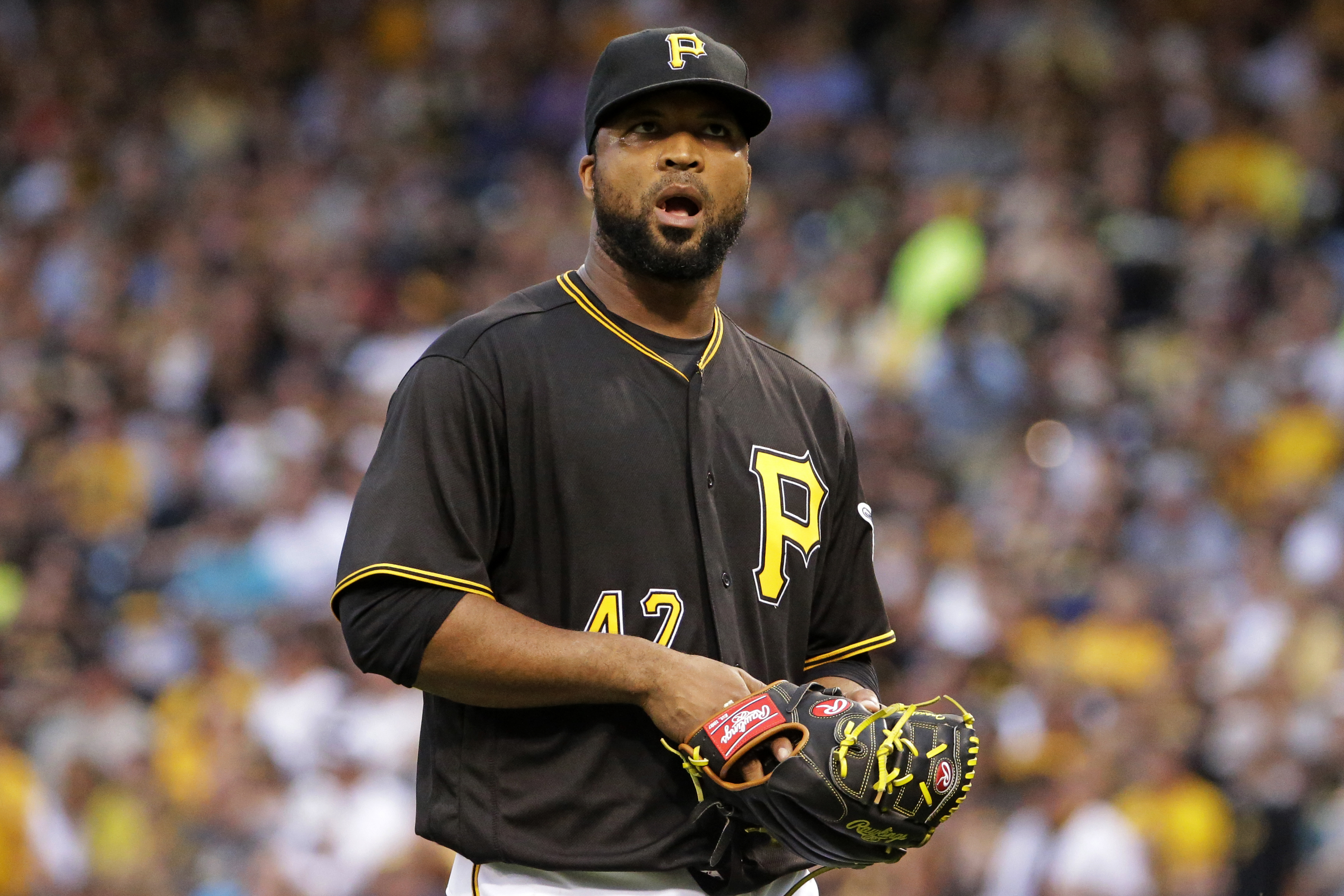 Pittsburgh Pirates starting pitcher Francisco Liriano walks to the dugout after being pulled by manager Clint Hurdle during the fourth inning of a baseball game against the Seattle Mariners in Pittsburgh, Tuesday, July 26, 2016. (AP Photo/Gene J. Puskar)