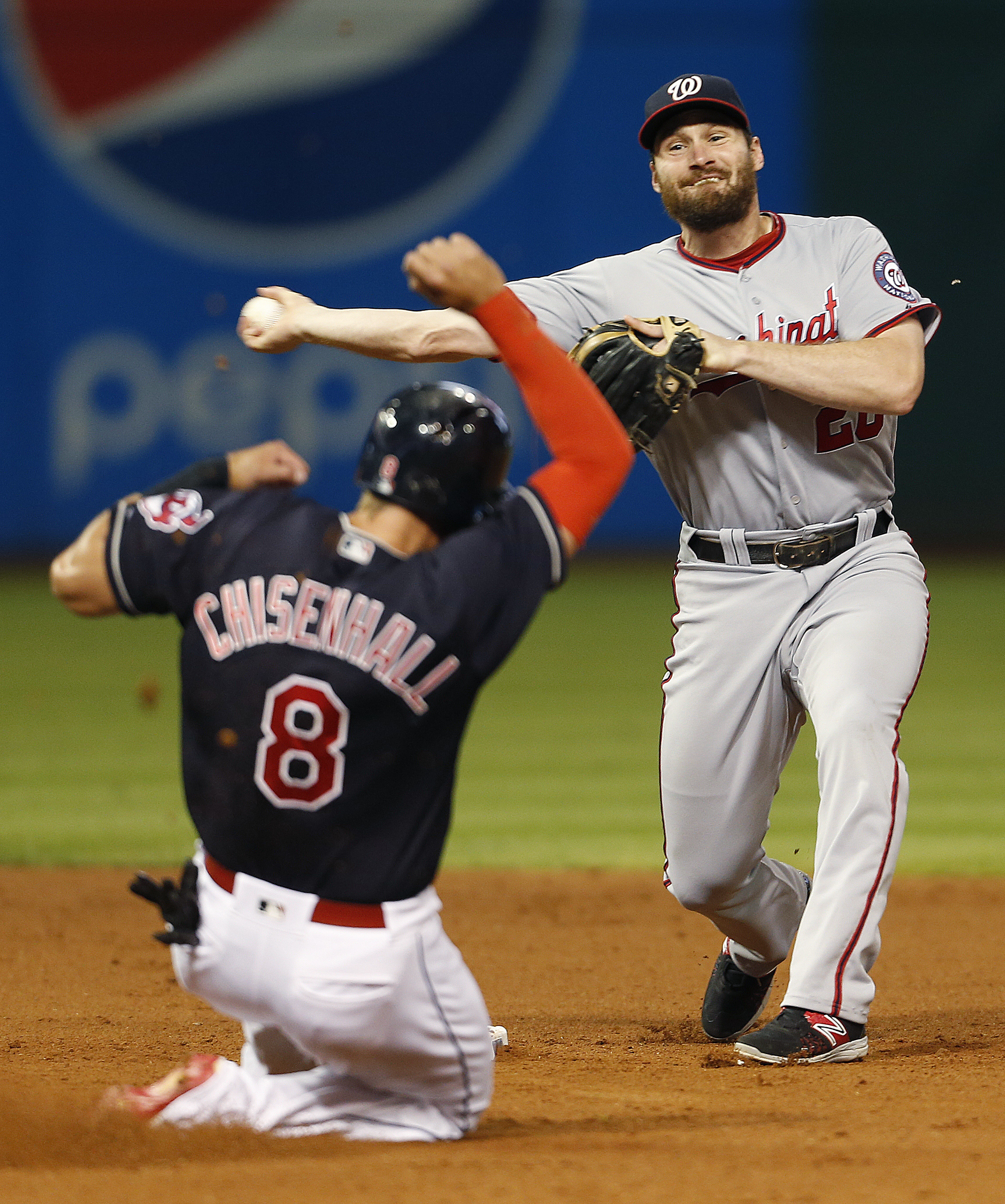 Washington Nationals' Daniel Murphy (20) throws to first after forcing out Cleveland Indians' Lonnie Chisenhall (8) at second base during the seventh inning of a baseball game Tuesday, July 26, 2016, in Cleveland. Rajai Davis was out at first. (AP Photo/R