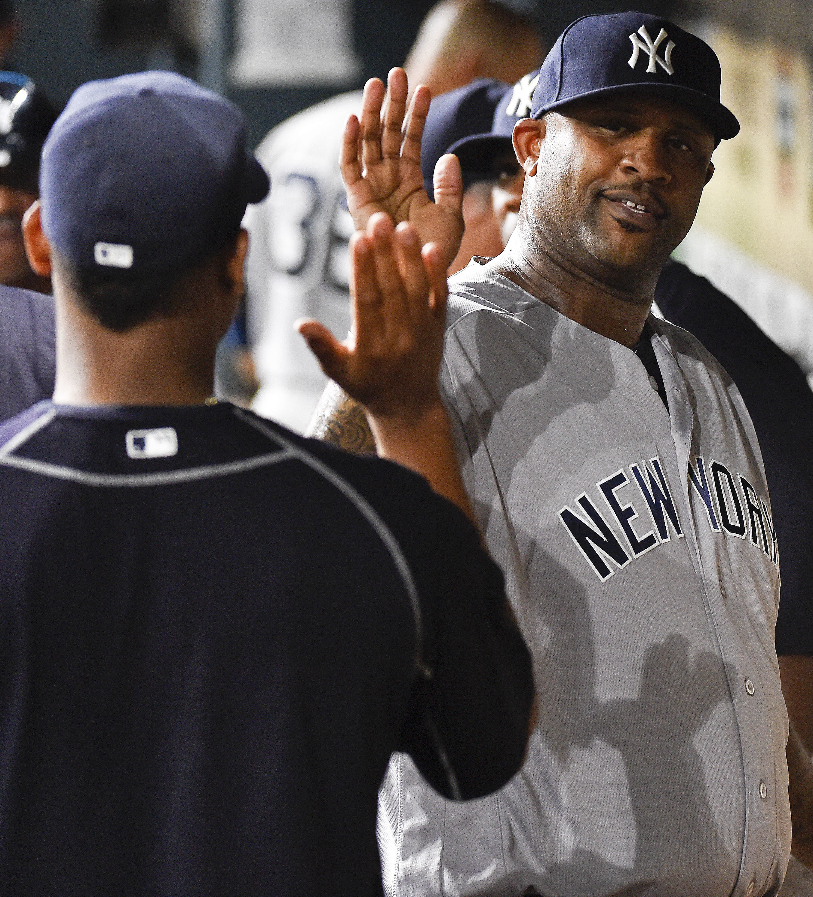 New York Yankees starting pitcher CC Sabathia, right, high-fives a teammate in the dugout after being taken out of the baseball game in the seventh inning against the Houston Astros, Tuesday, July 26, 2016, in Houston. (AP Photo/Eric Christian Smith)