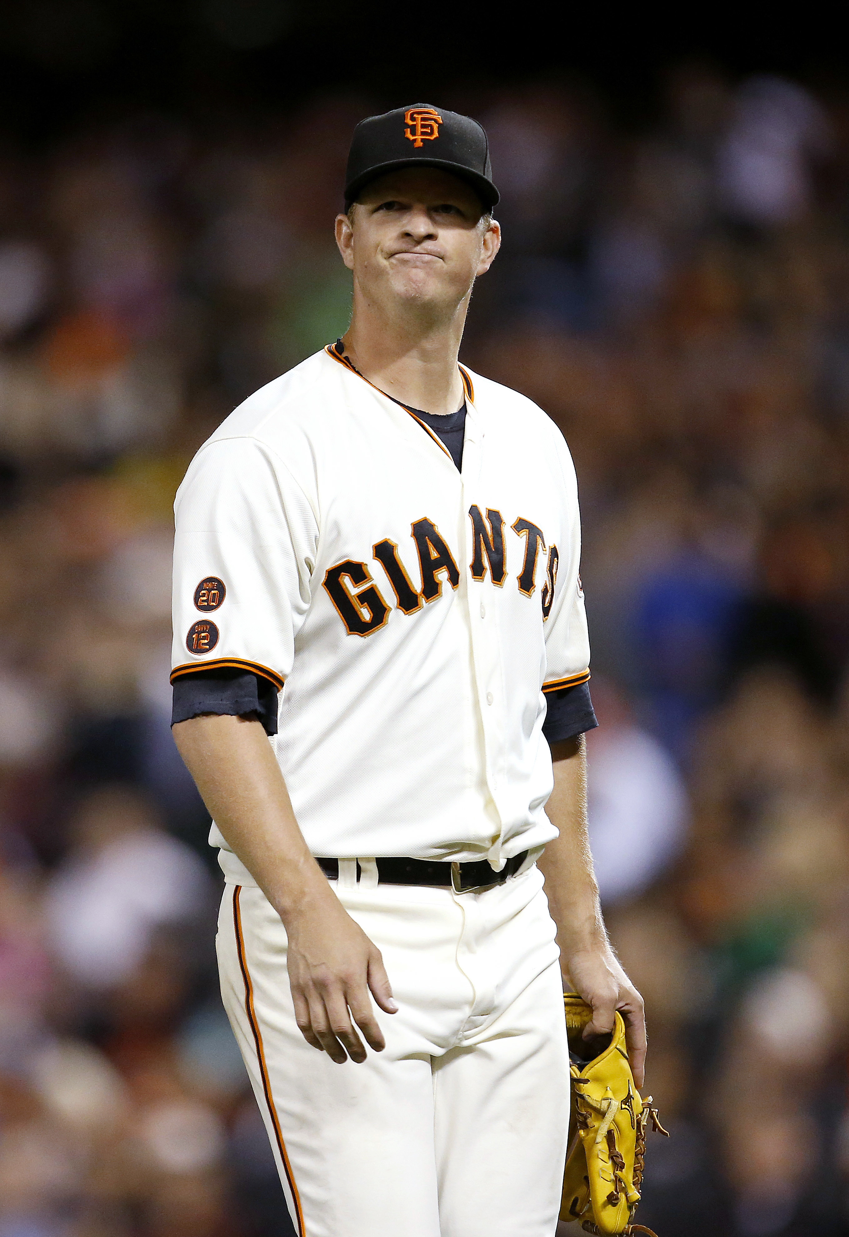 San Francisco Giants pitcher Matt Cain reacts after being taken out of the baseball game against the Cincinnati Reds during the sixth inning Tuesday, July 26, 2016, in San Francisco. (AP Photo/Tony Avelar)