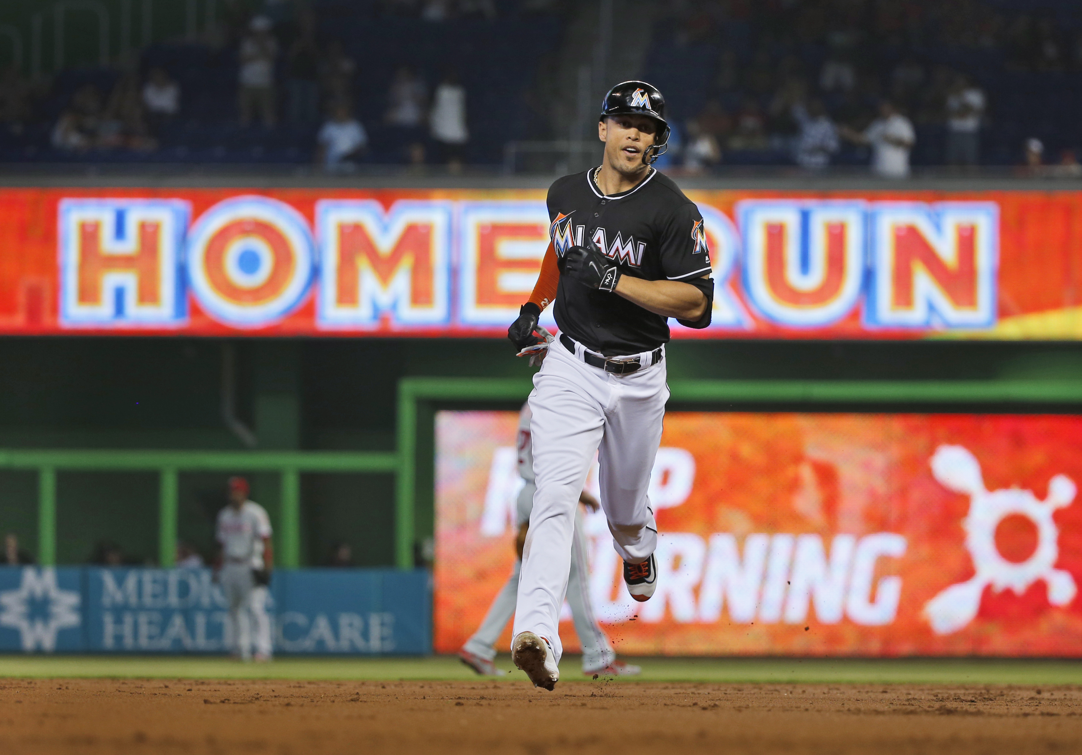 Miami Marlins' Giancarlo Stanton rounds second base as he heads for home after hitting a home run during the first inning of a baseball game against the Philadelphia Phillies, Wednesday, July 27, 2016, in Miami. (AP Photo/Wilfredo Lee)
