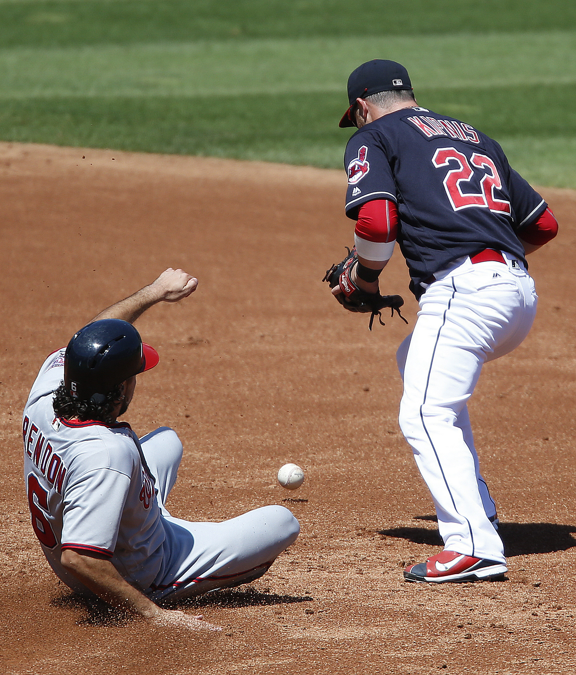Cleveland Indians' Jason Kipnis (22) bobbles the exchange after forcing out Washington Nationals' Anthony Rendon (6) at second base, preventing him from turning the double play during the first inning of a baseball game Wednesday, July 27, 2016, in Clevel
