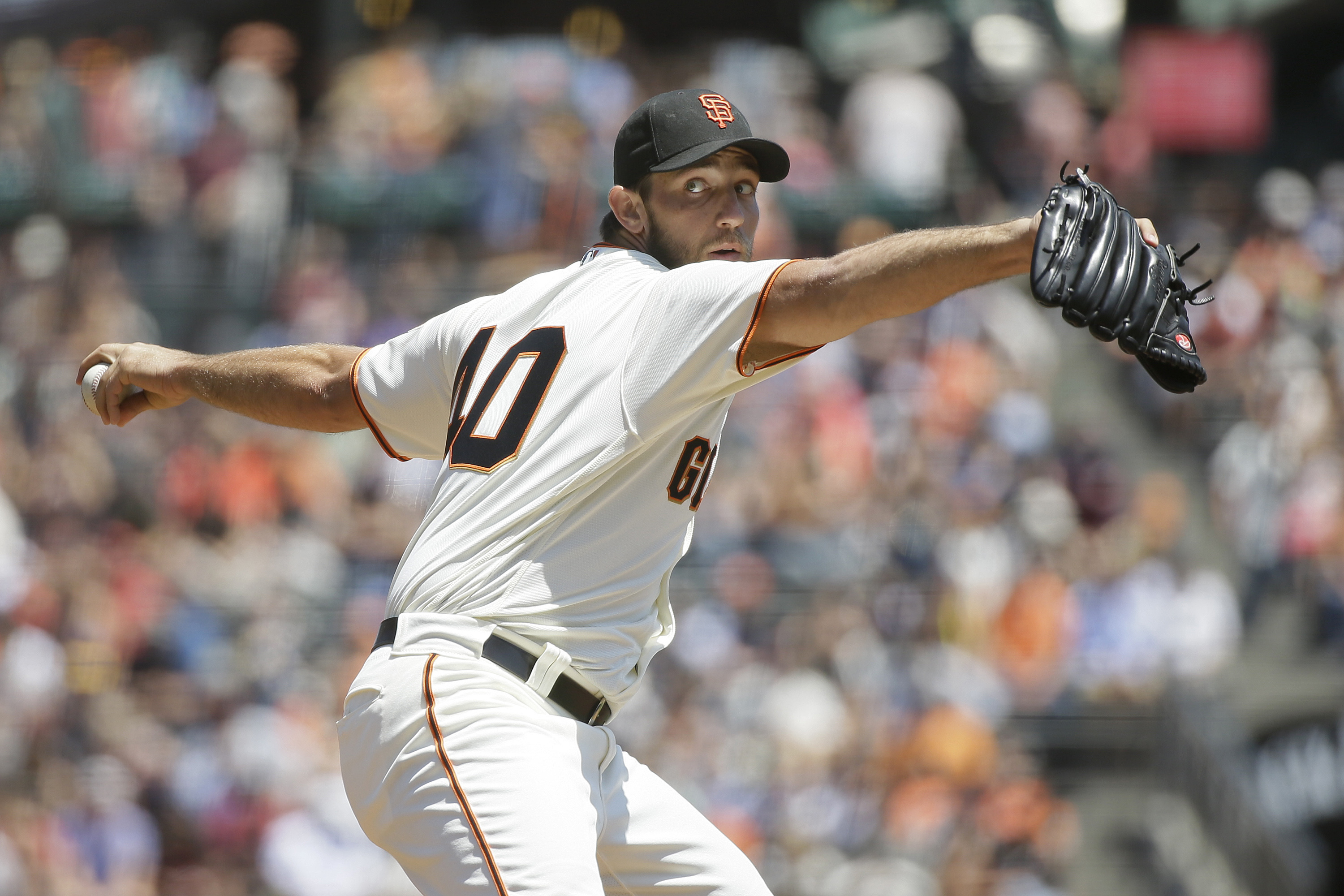 San Francisco Giants starting pitcher Madison Bumgarner throws in the first inning of a baseball game against the Cincinnati Reds Wednesday, July 27, 2016, in San Francisco. (AP Photo/Eric Risberg)