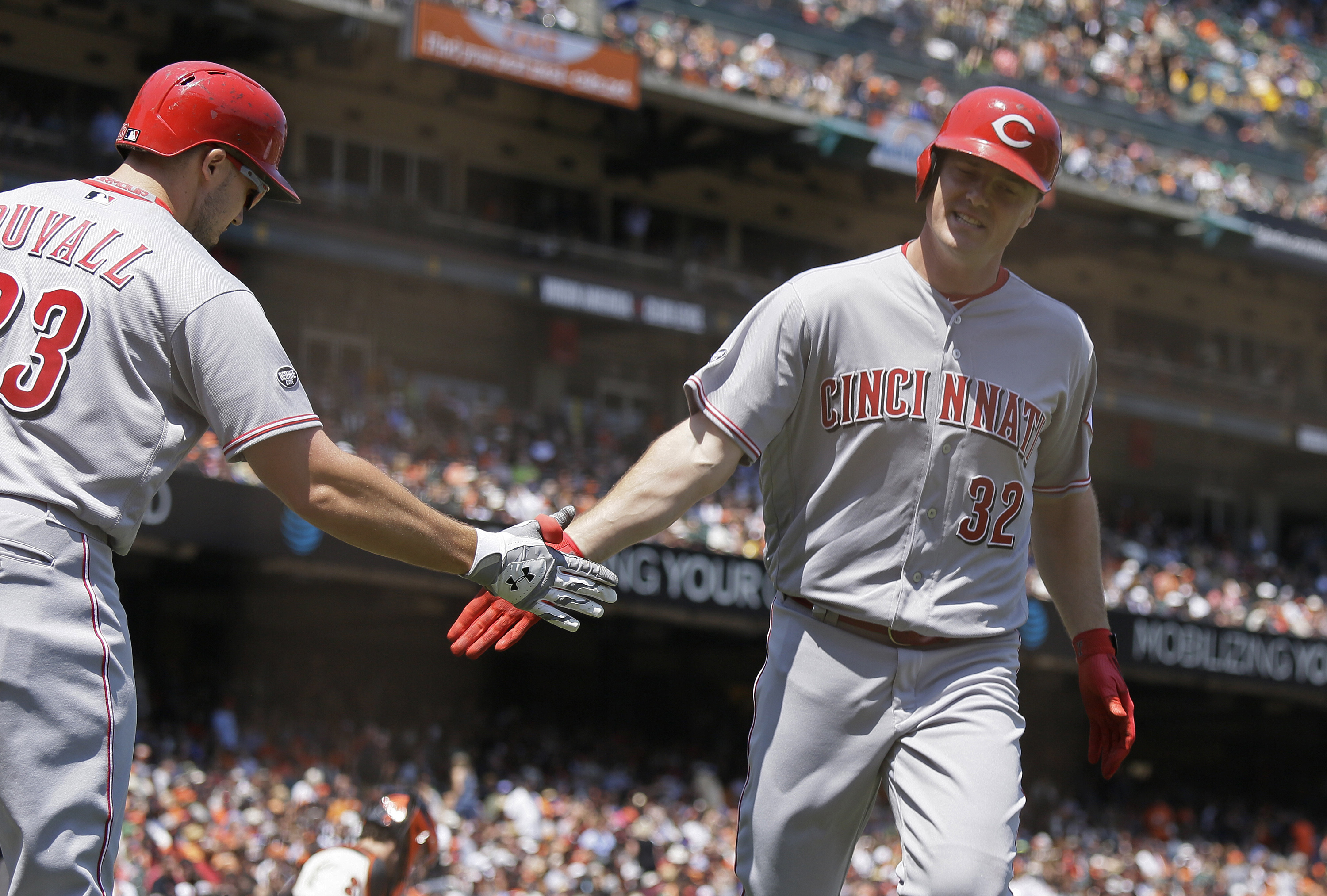 Cincinnati Reds' Jay Bruce, right, is greeted by Adam Duvall, left, after hitting a home run off San Francisco Giants starting pitcher Madison Bumgarner during the seventh inning of a baseball game Wednesday, July 27, 2016, in San Francisco. Cincinnati wo