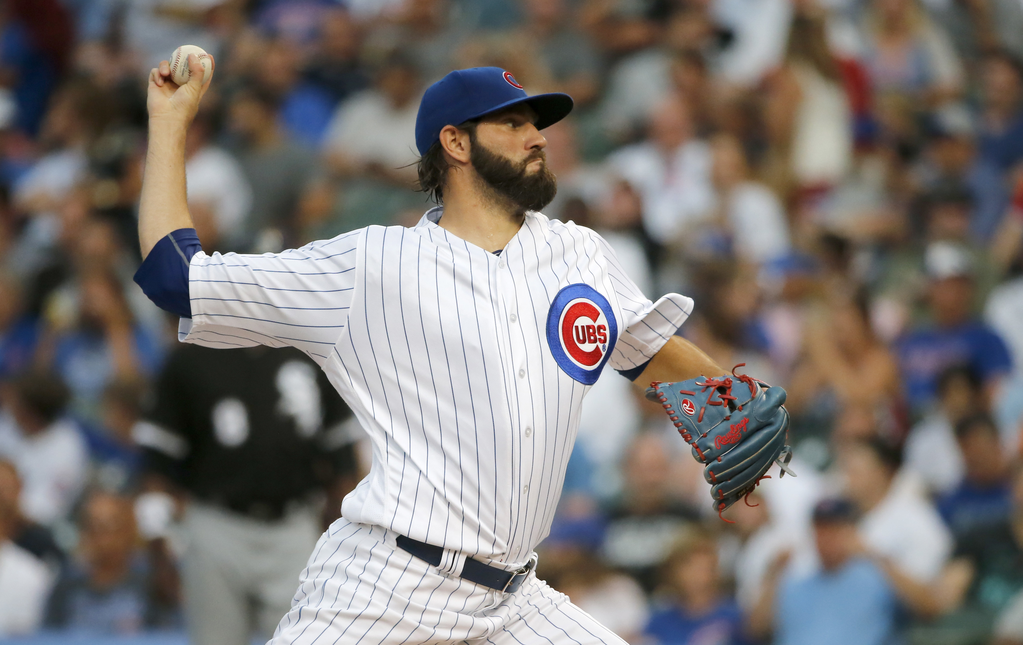 Chicago Cubs starting pitcher Jason Hammel winds up during the first inning of a baseball game against the Chicago White Sox on Wednesday, July 27, 2016, in Chicago. (AP Photo/Charles Rex Arbogast)