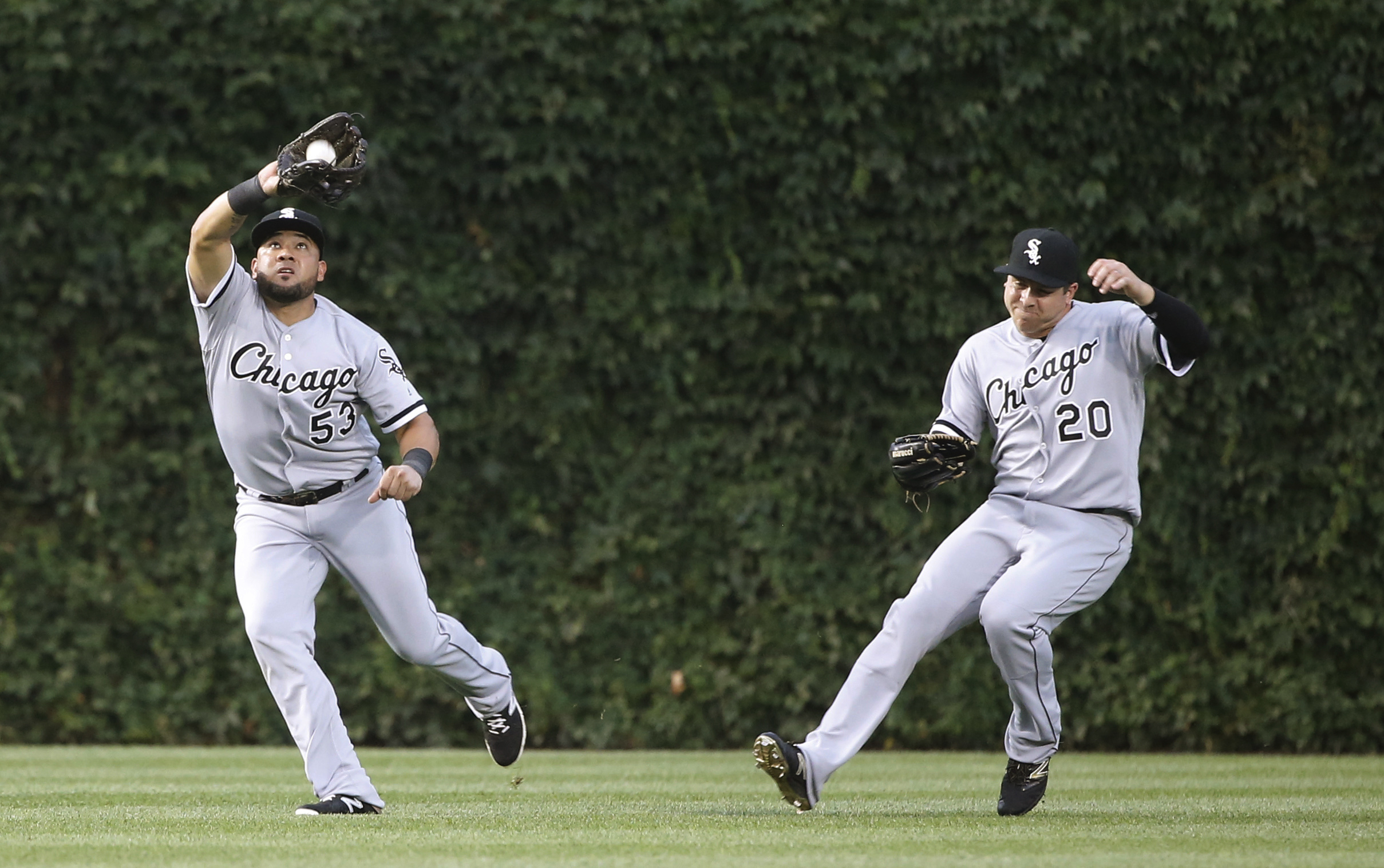 Chicago White Sox left fielder Melky Cabrera (53) catches a fly ball from Chicago Cubs' Anthony Rizzo as center fielder J.B. Shuck avoids a collision during the third inning of a baseball game Thursday, July 28, 2016, in Chicago. (AP Photo/Charles Rex Arb
